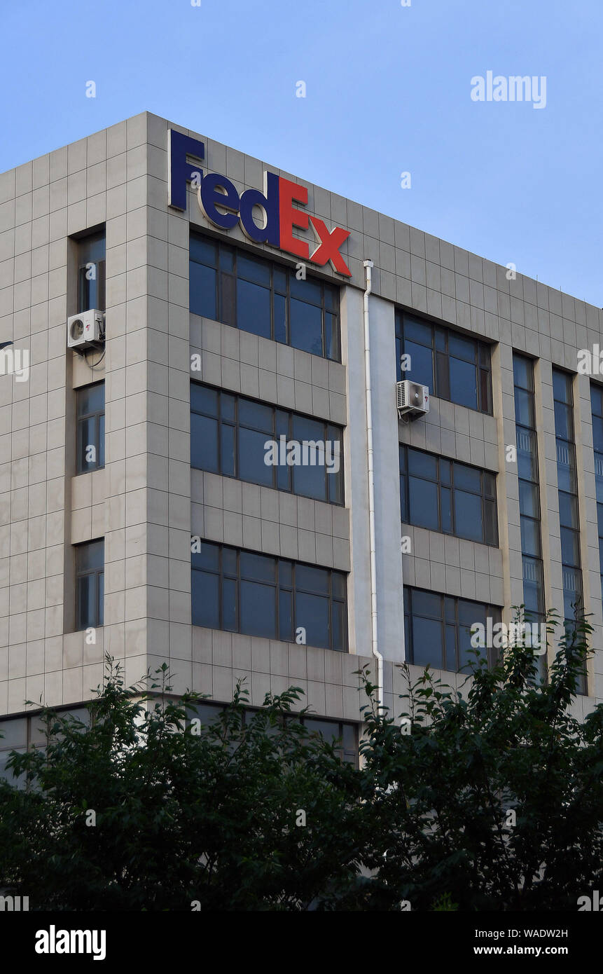 FILE--A signboard of U S  courier delivery company FedEx