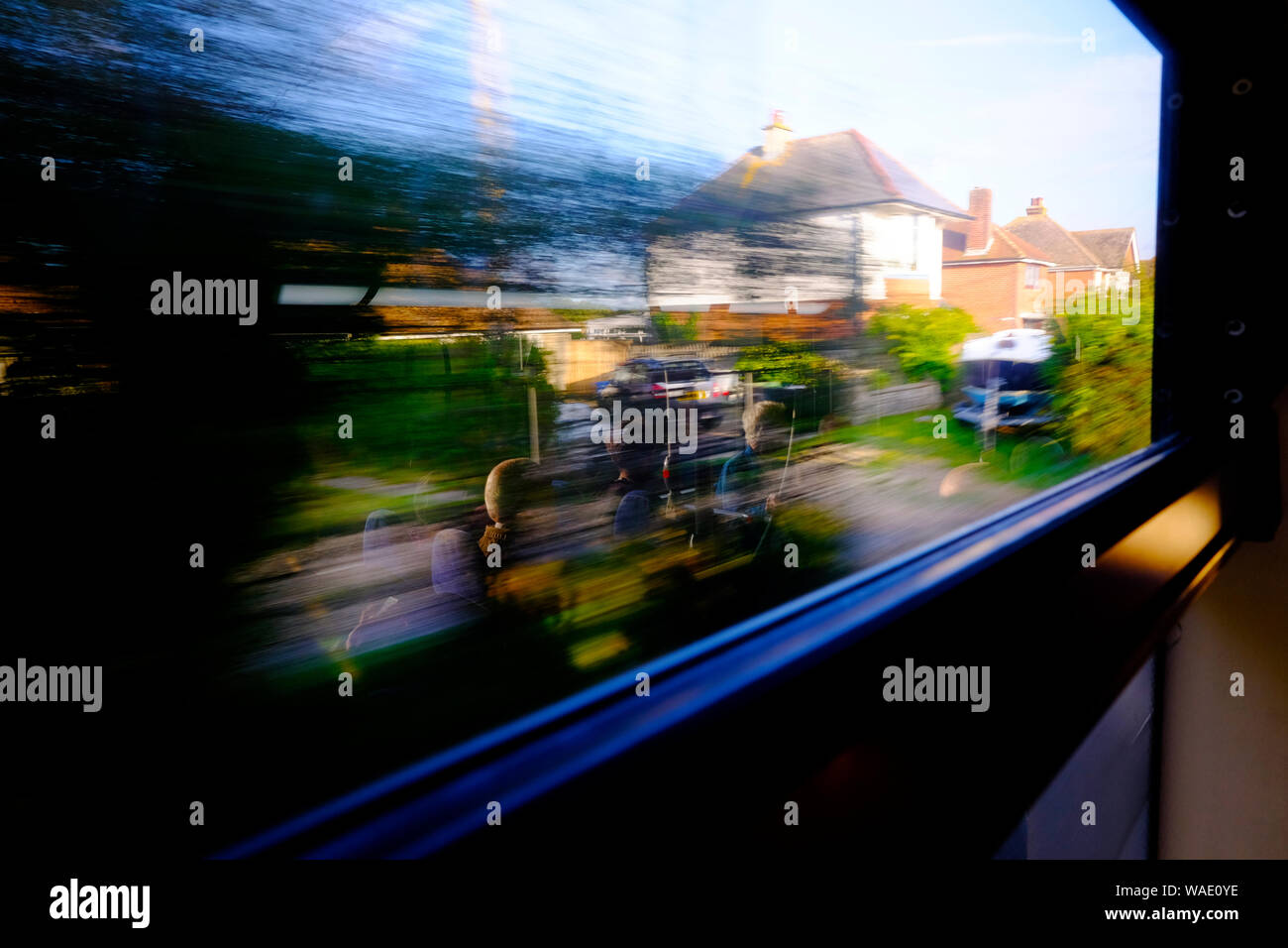 Bus travel movement passenger window reflections Stock Photo