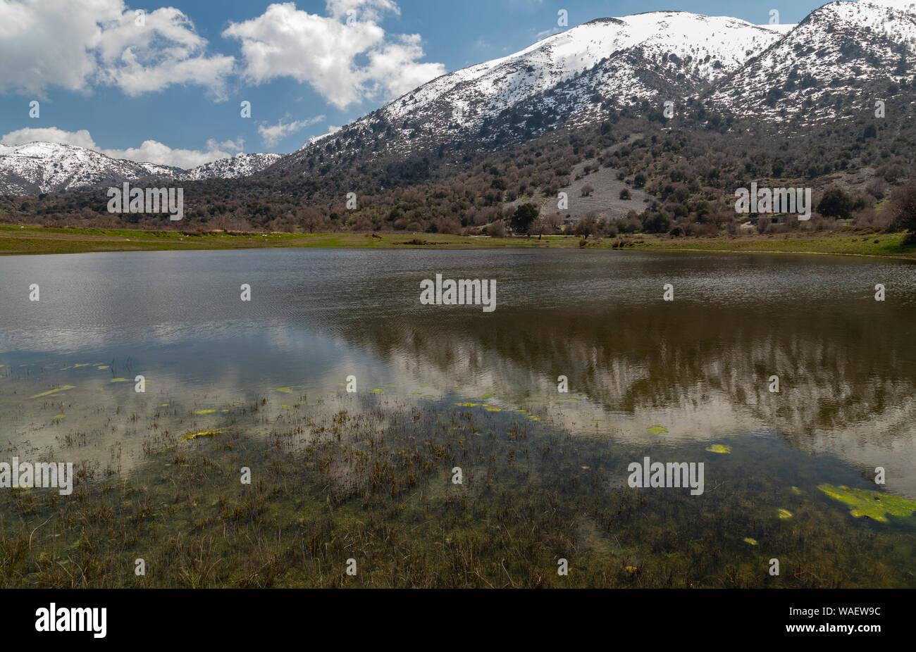 Omalos pond, a Mediterranean Temporary Pond on the Omalos plateau, White mountains, Crete. Stock Photo