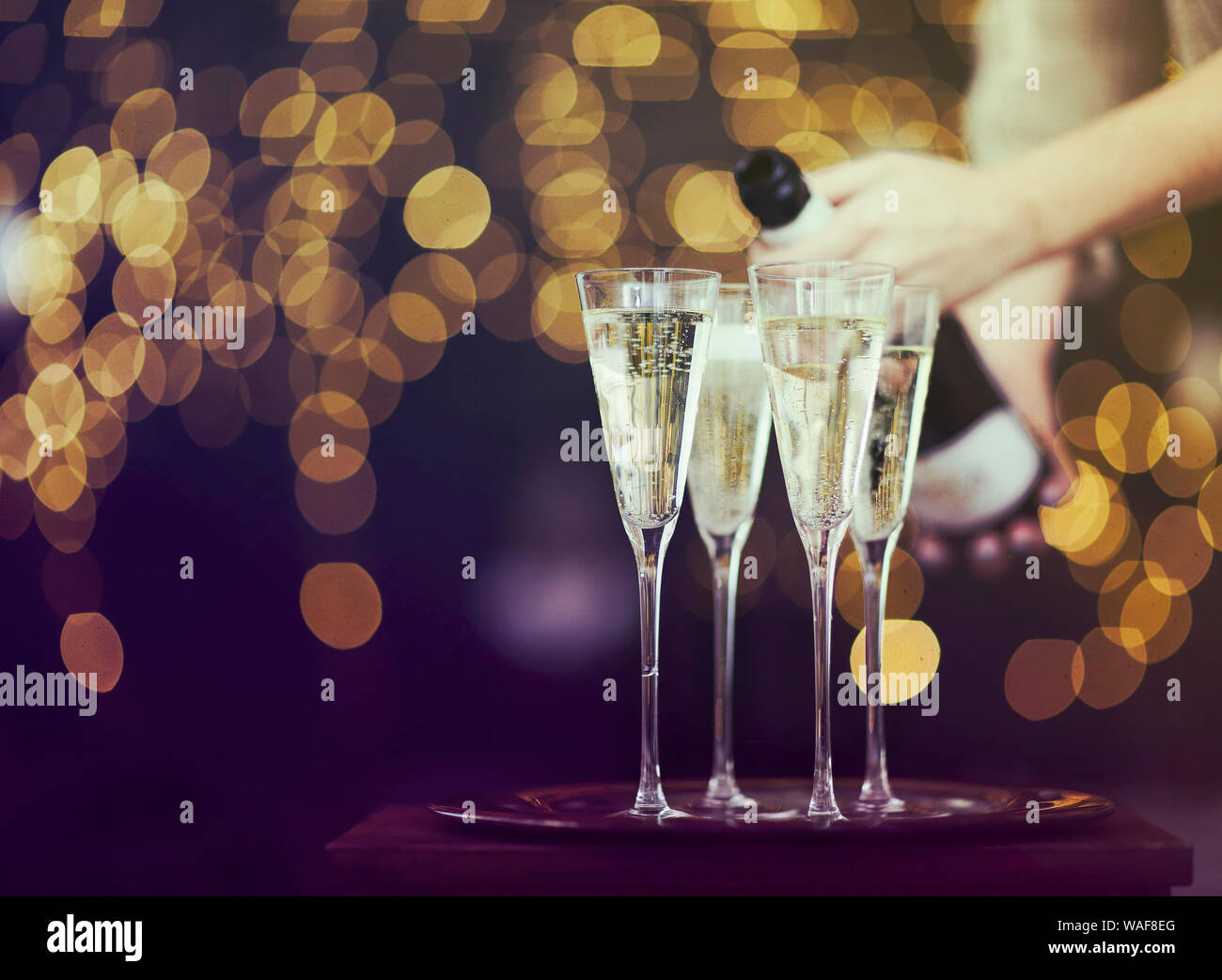 Champagne glasses on lights background. Christmas celebration background Stock Photo
