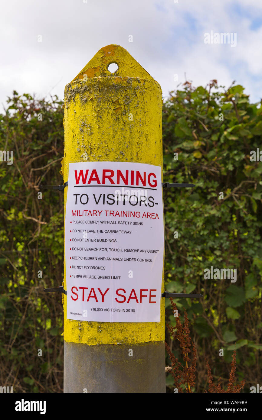 open day for visitors to see the deserted ghost village of Imber on Salisbury Plain, Wiltshire UK in August - warning poster on post Stock Photo