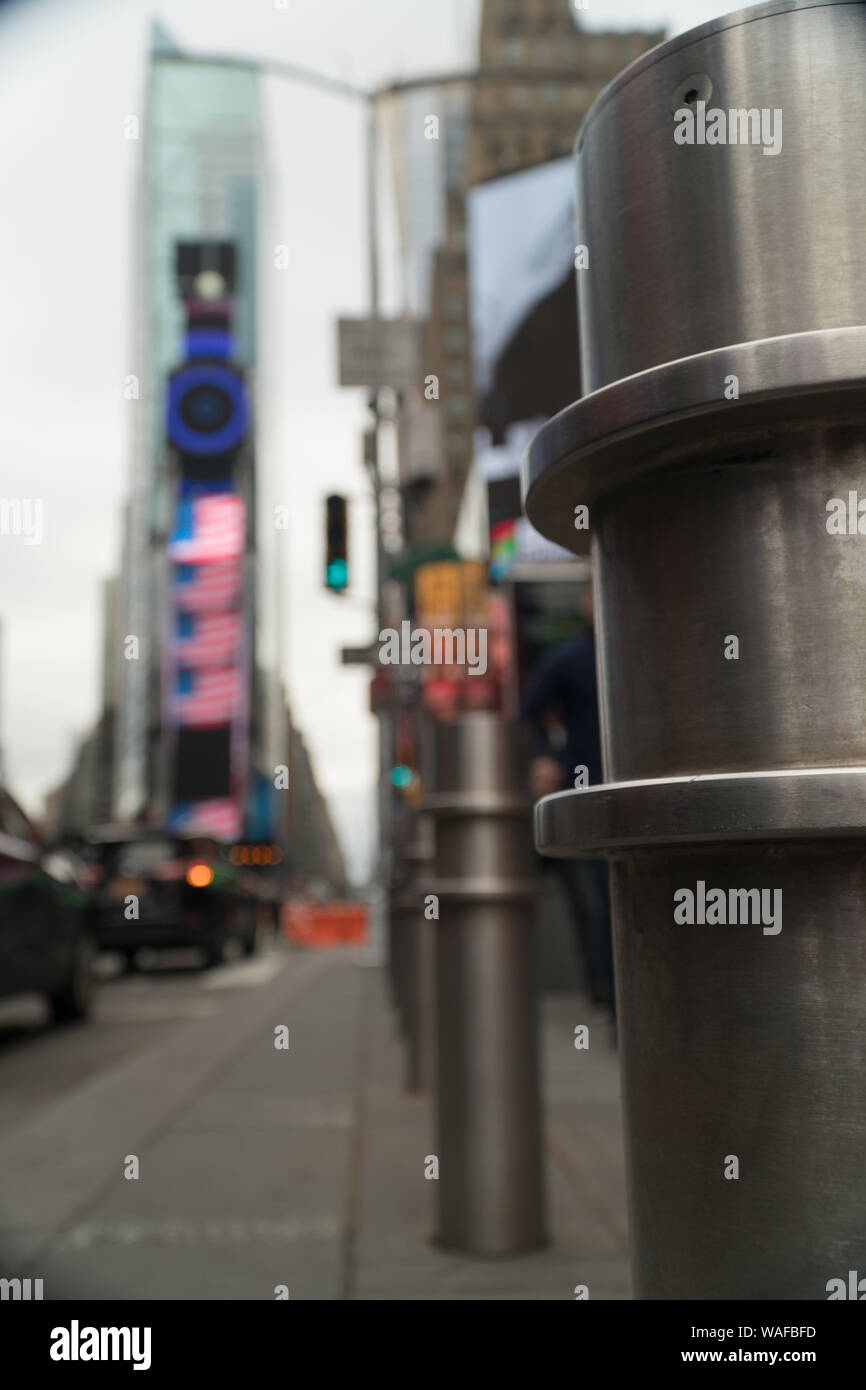 Safety pylons along sidewalk in Times Square, NY to protect