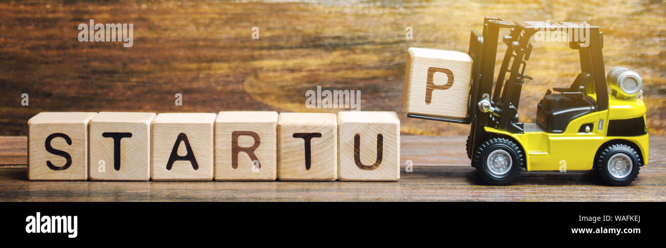 Wooden blocks with the word Startup. Temporary structure designed to find and implement a scalable business model. The concept of raising funds for a Stock Photo