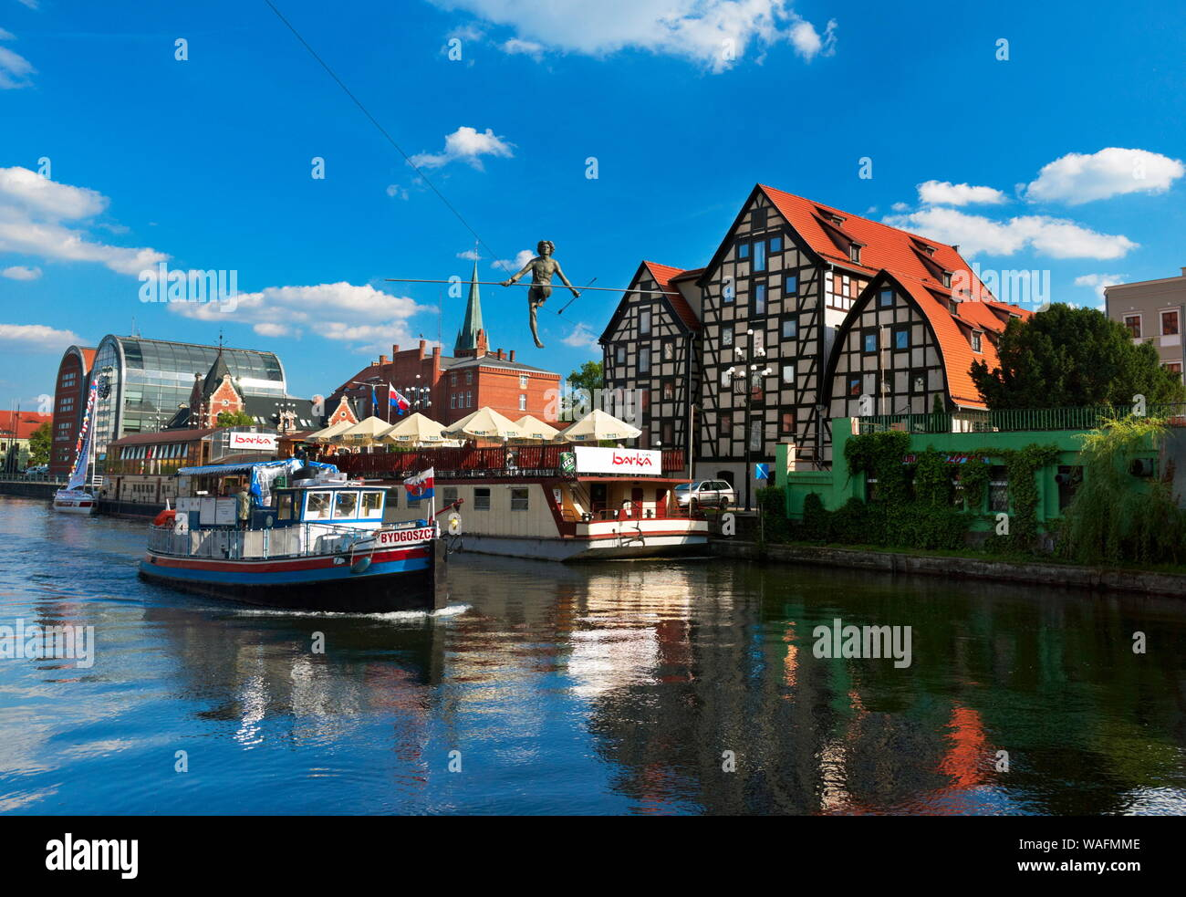 Bydgoszcz, Northern Poland, view from the Brda river cinty centre; relic granaries, 'Passing the River' figure hanging above the Brda river. Installed on May 1st 2004, the day Poland accessed the EU. Bydgoszcz in Kuyavia (Kujawy) region phot. Jan Wlodarczyk/FORUM Stock Photo