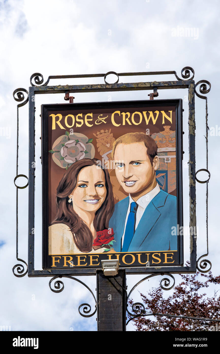 Rose & Crown free house pub sign with Will and Kate at Tilshead, near Salisbury, Wiltshire UK in August Stock Photo