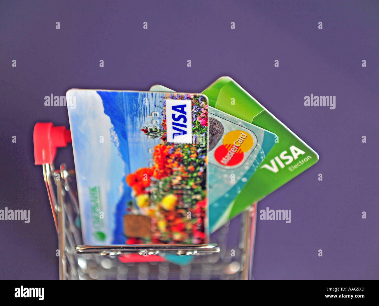 Yaroslavl, Russia - August 20, 2019: Mini shopping trolley with credit cards on the table. Stock Photo