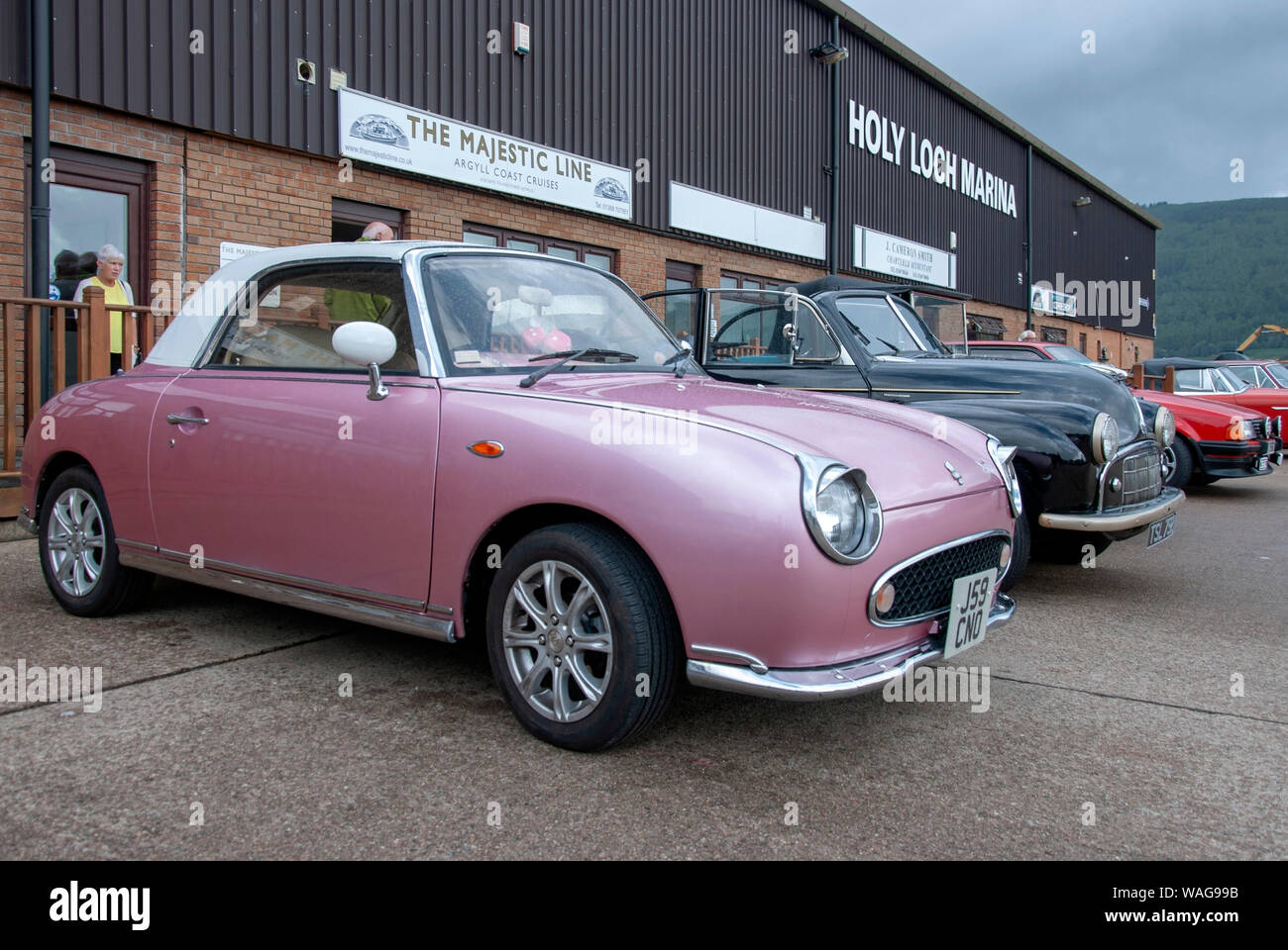 1991 Pink Retro Style Nissan Figaro 2 Door Fixed Profile Convertible White Roof Front Drivers Side Offside View Japanese City Car Parked Holy Loch Mar Stock Photo Alamy