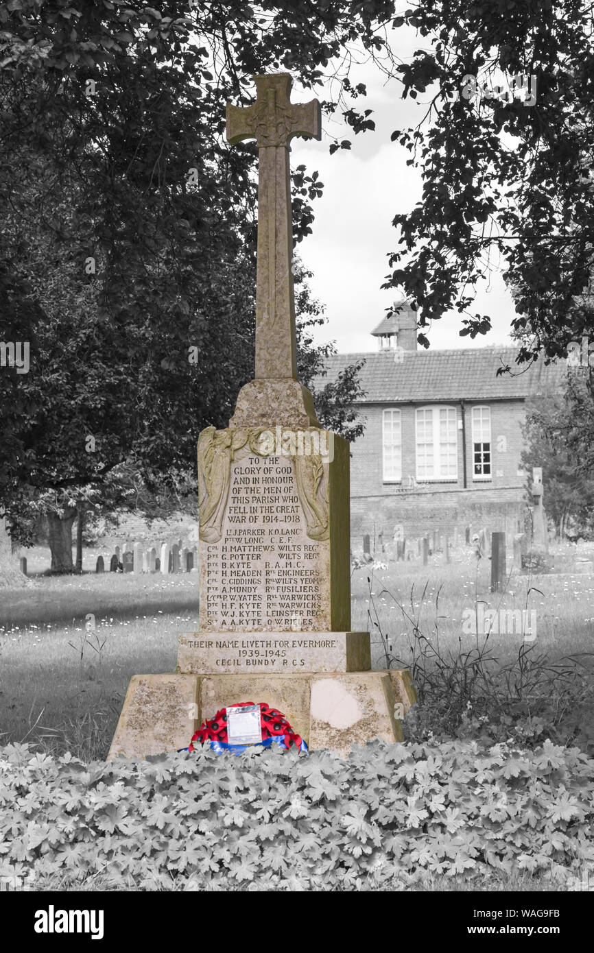 Tilshead War Memorial in churchyard of St Thomas a Becket church at Tilshead, near Salisbury, Wiltshire UK in August in monochrome with colour popping Stock Photo