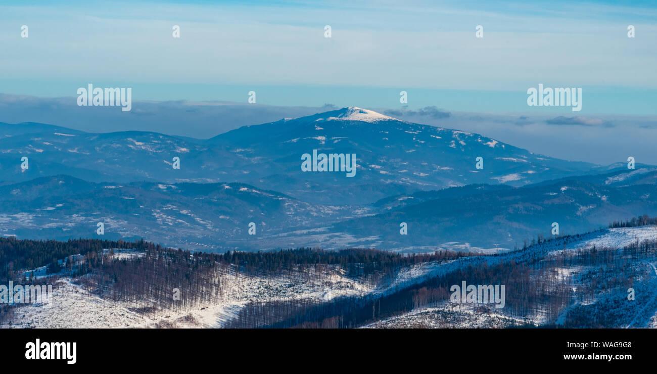 Babia Gora hill in Beskid Zywiecki mountains from Malinowska Skala hill in Beskid Slaski mountains in Poland during nice winter day Stock Photo