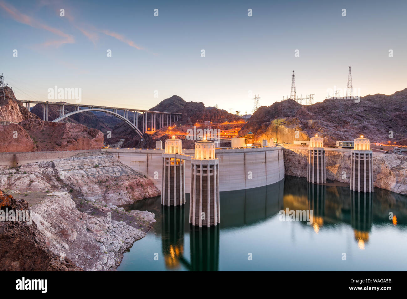 Hooover Dam on the Colorado River straddling Nevada and Arizona at dusk. Stock Photo