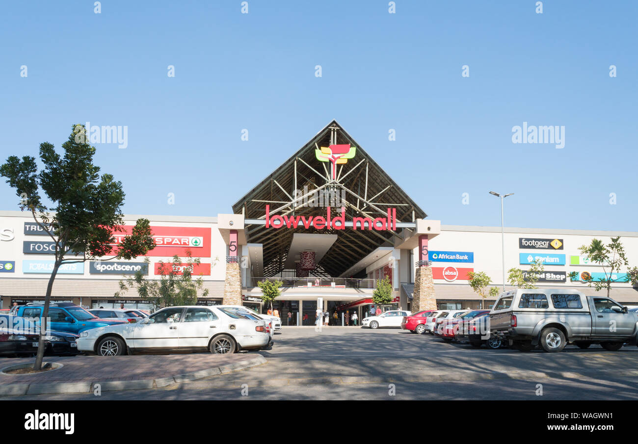 view onto the front of Lowveld shopping centre or mall in Hazyview, Mpumalanga, South Africa with parked or stationary vehicles or cars Stock Photo