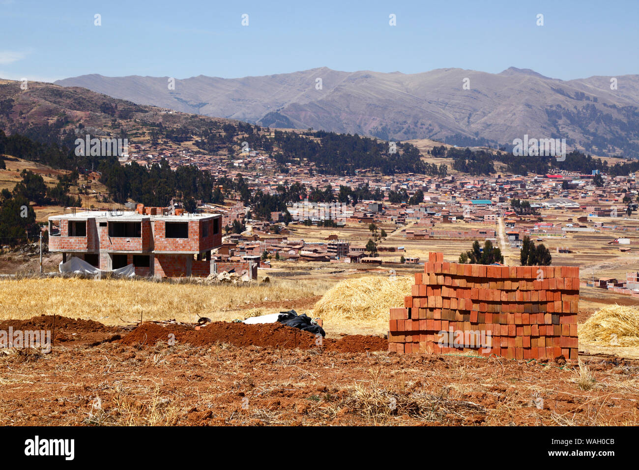 Building Under Construction At Nuevo Chinchero Near The Original Village Of Chinchero In Background Financed By This background are in hdr cb background. alamy