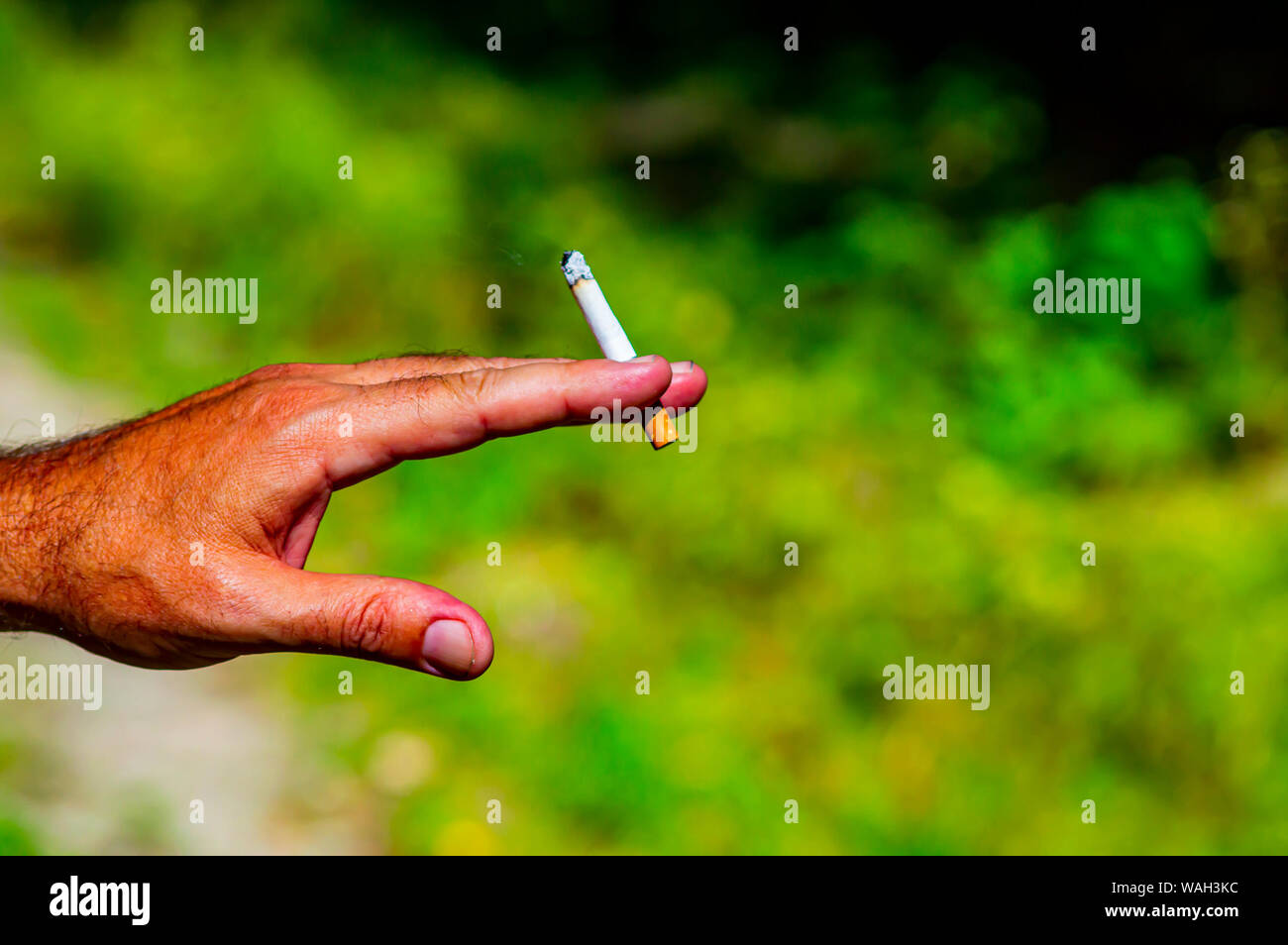 Cigarette in a male hand  Social problems  Lifestyle