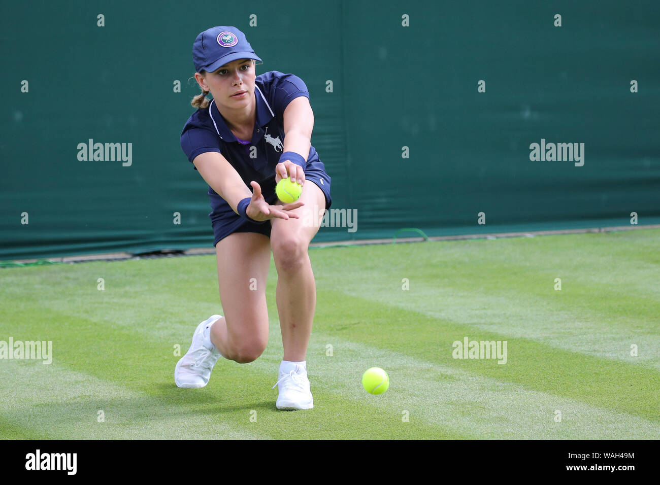 Ball Girl in action during 2019 Wimbledon Championships, London, England, United Kingdom Stock Photo