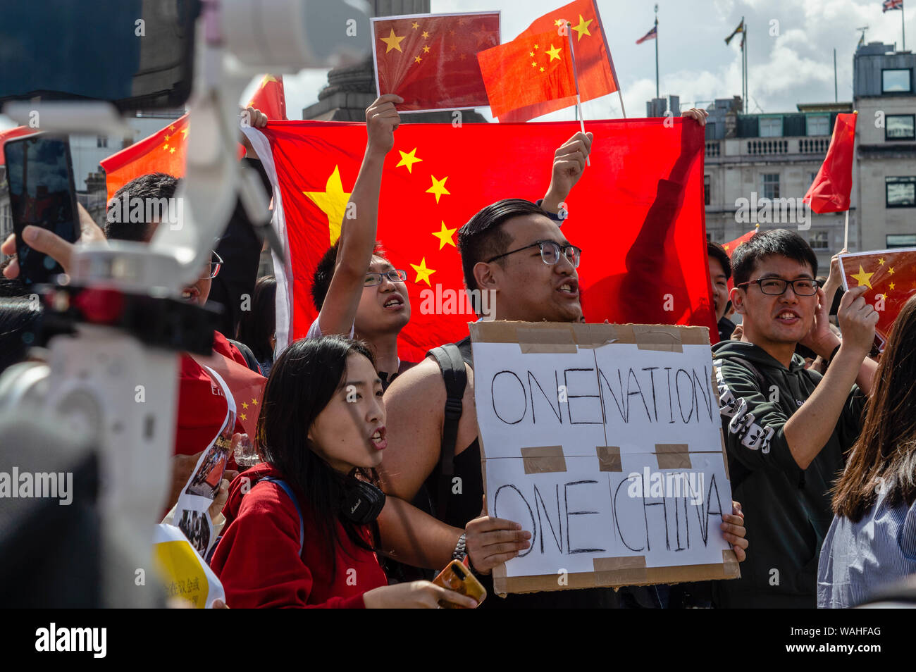 London, United Kingdom - August 17,  2019: Chinese citizens in opposition of the UK Solidarity with Hong Kong Rally. Stock Photo