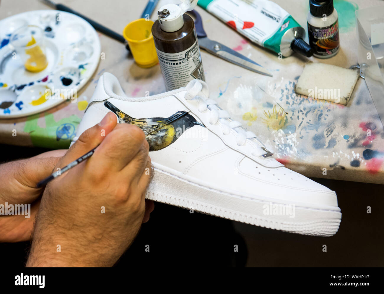 cheap for discount 8d66c a5a10 Hamburg, Germany. 30th July, 2019. A sneaker is painted in ...