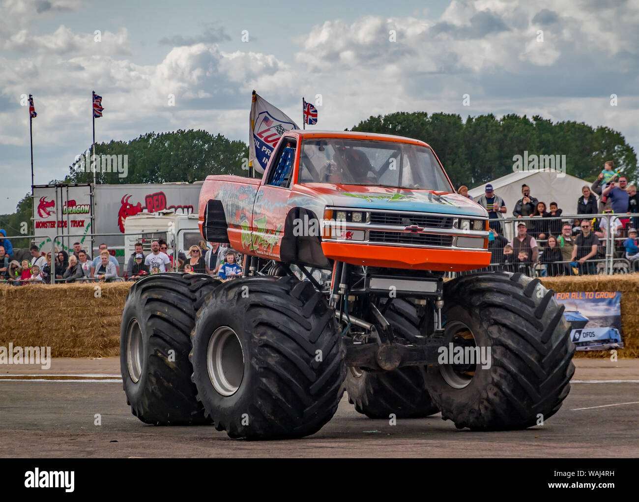 The Podzilla monster truck spinning up its tires during a