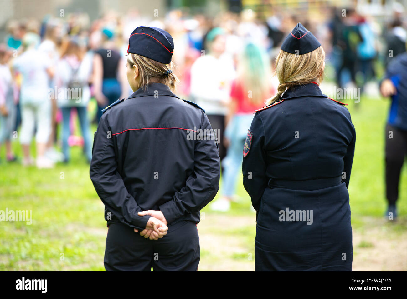 Chelyabinsk Region, Russia - June 2019: female police officers are watching the crowding. Two unidentified Russian police women in uniform monitor the Stock Photo