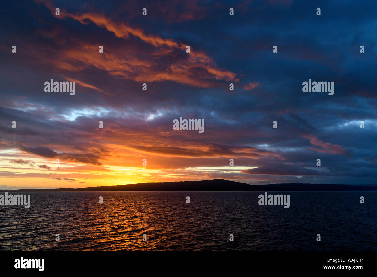 Argentina, Tierra del Fuego, Beagle Channel at sunset. Stock Photo
