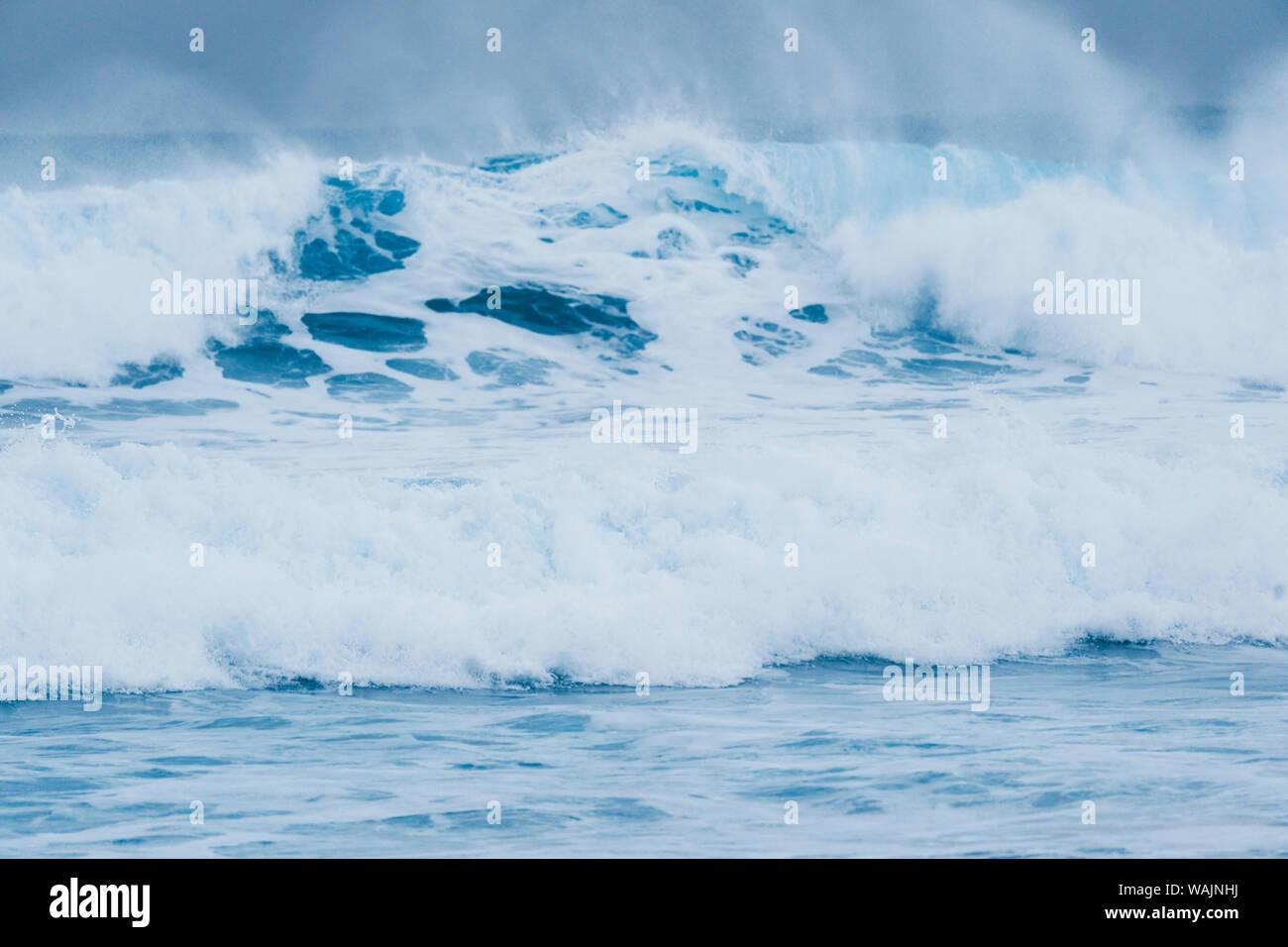 Norway, Lofoten Islands, Vestvag Island, Unstad. Waves along the coast near Unstad are popular for surfers even in winter. Stock Photo