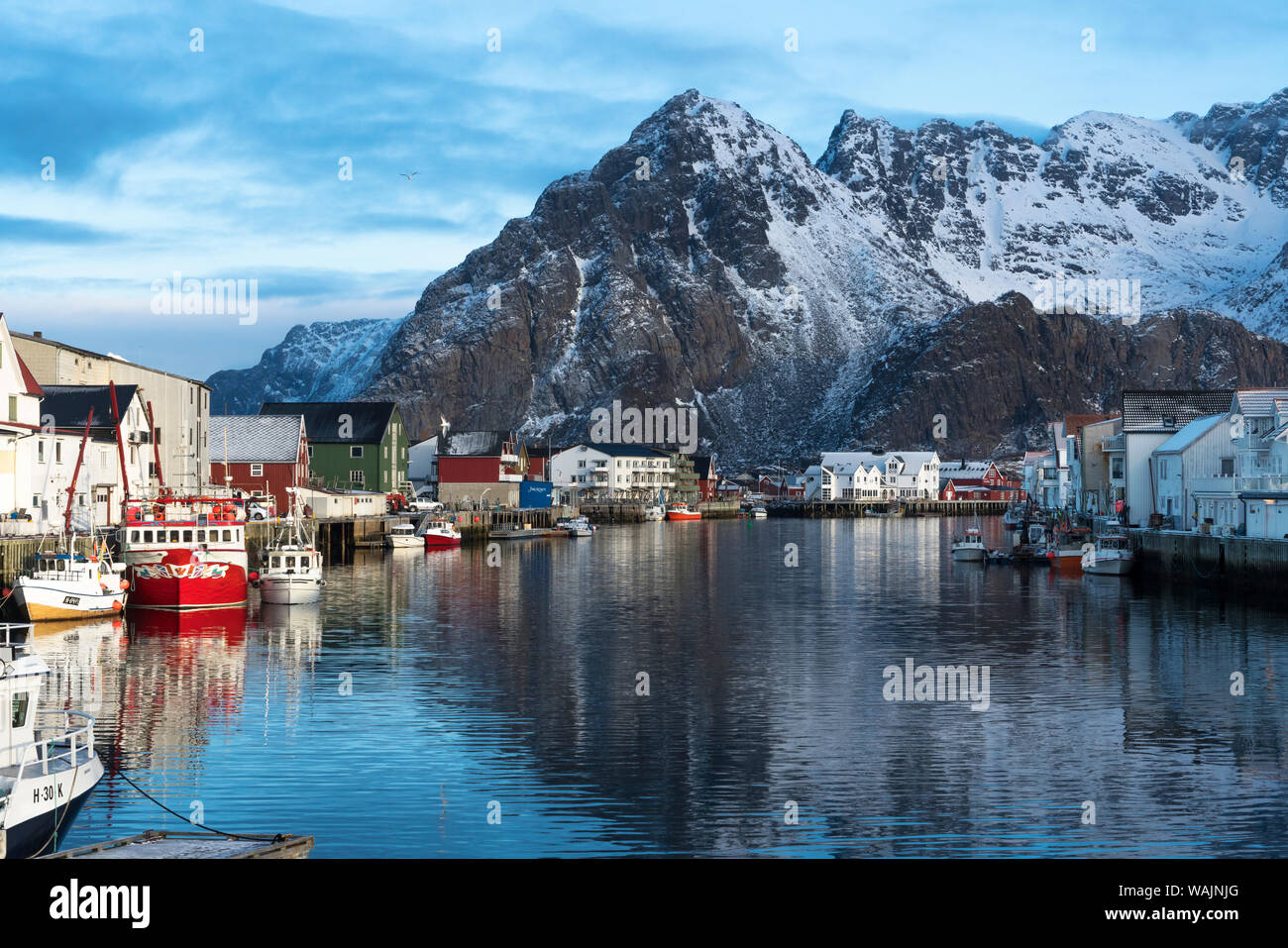 Norway, Lofoten Islands, Vestvag Island. A fishing village is set among dramatic mountains. Stock Photo