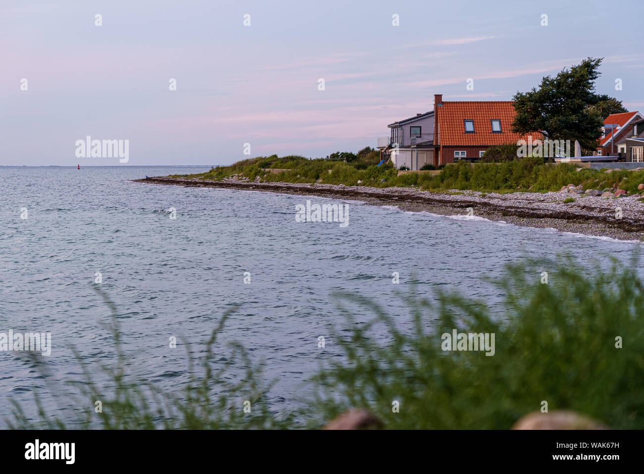 Evening at the beach house on the coast overlooking the Baltic Sea Stock Photo