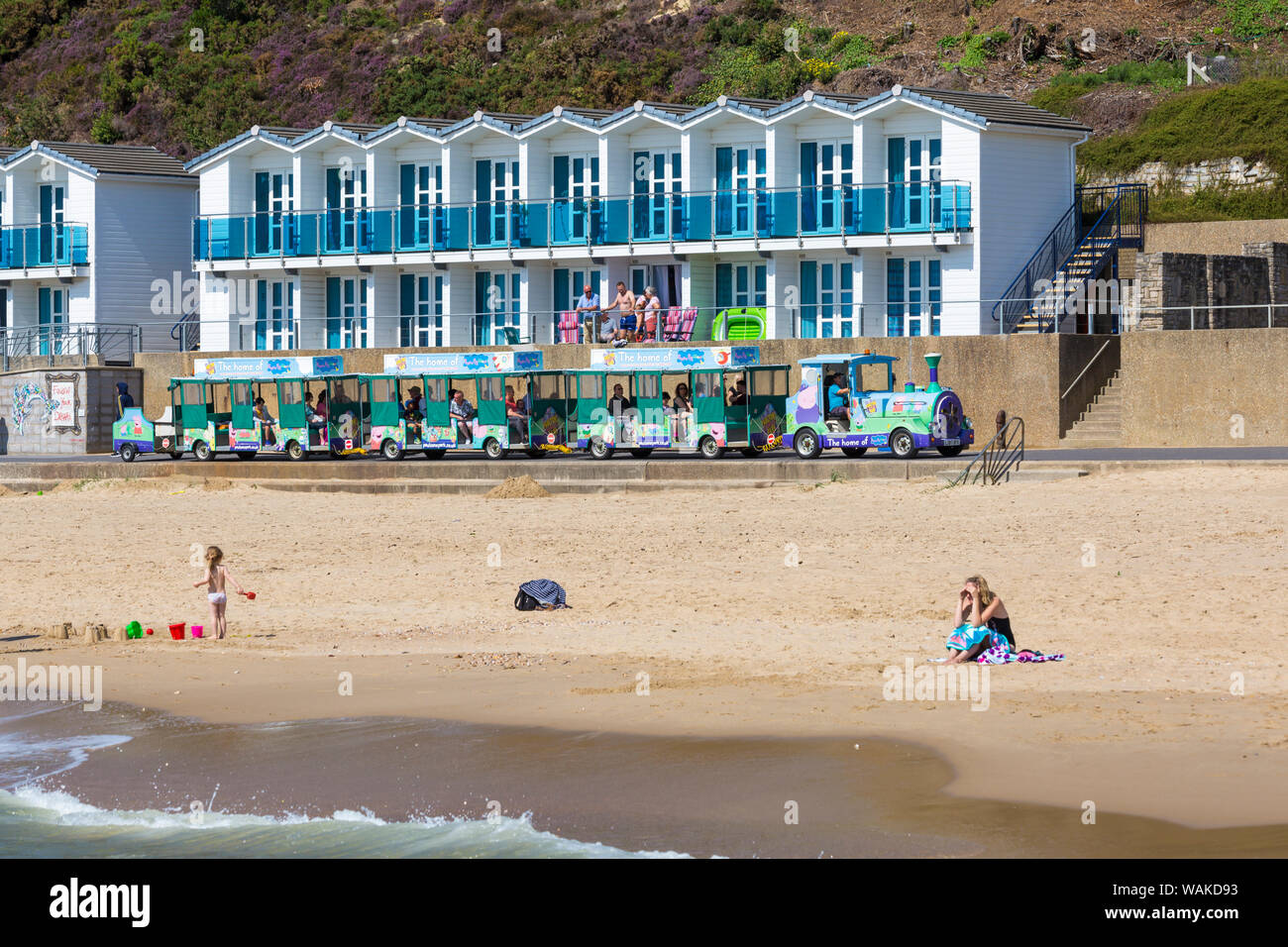 Beach and beach huts at Branksome Chine, Poole, Dorset UK on a warm sunny day in August Stock Photo