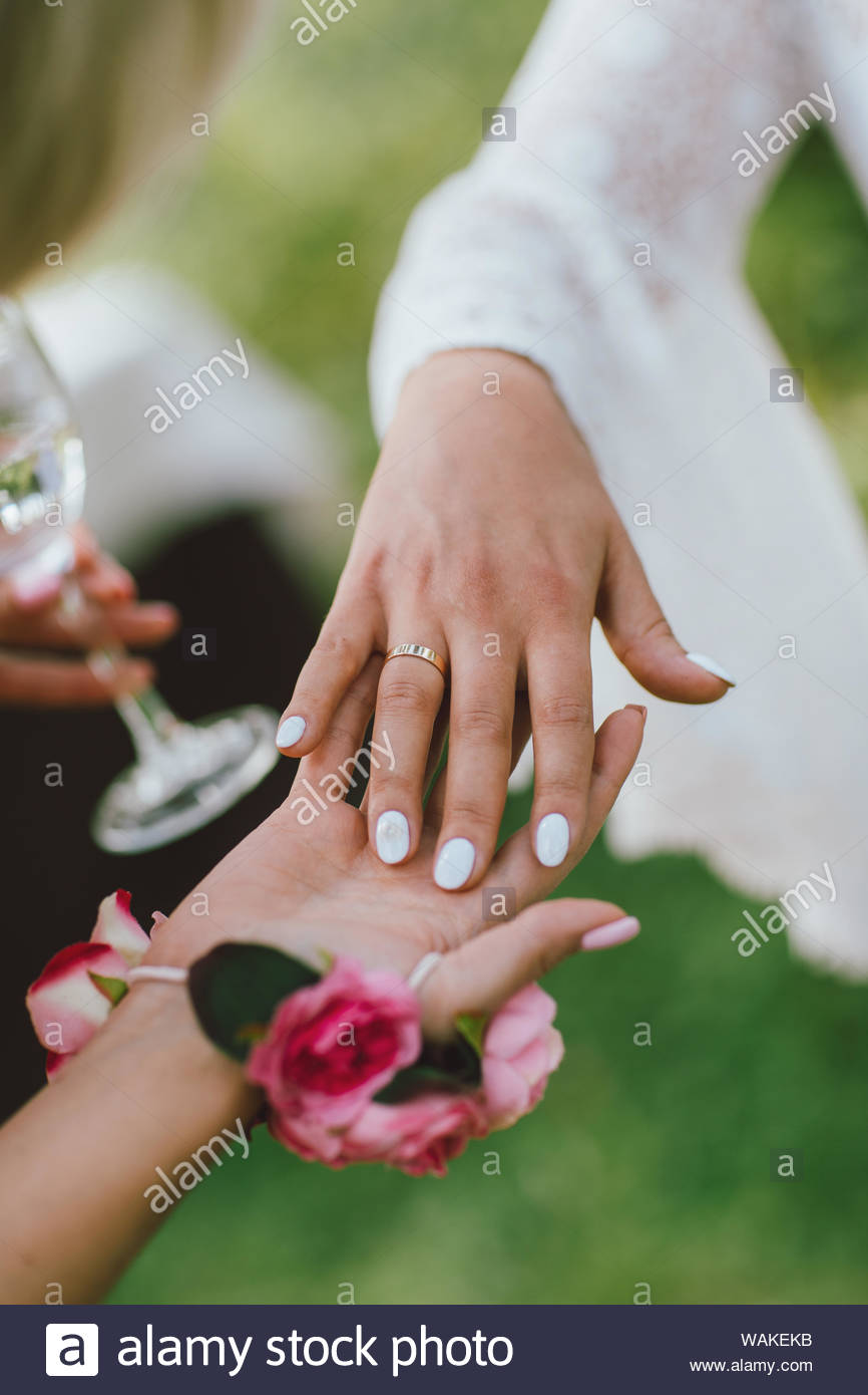 Which Hand Wedding Ring Female.Crop Photo Of The Female Hand With Wedding Ring Bridesmaids Stock