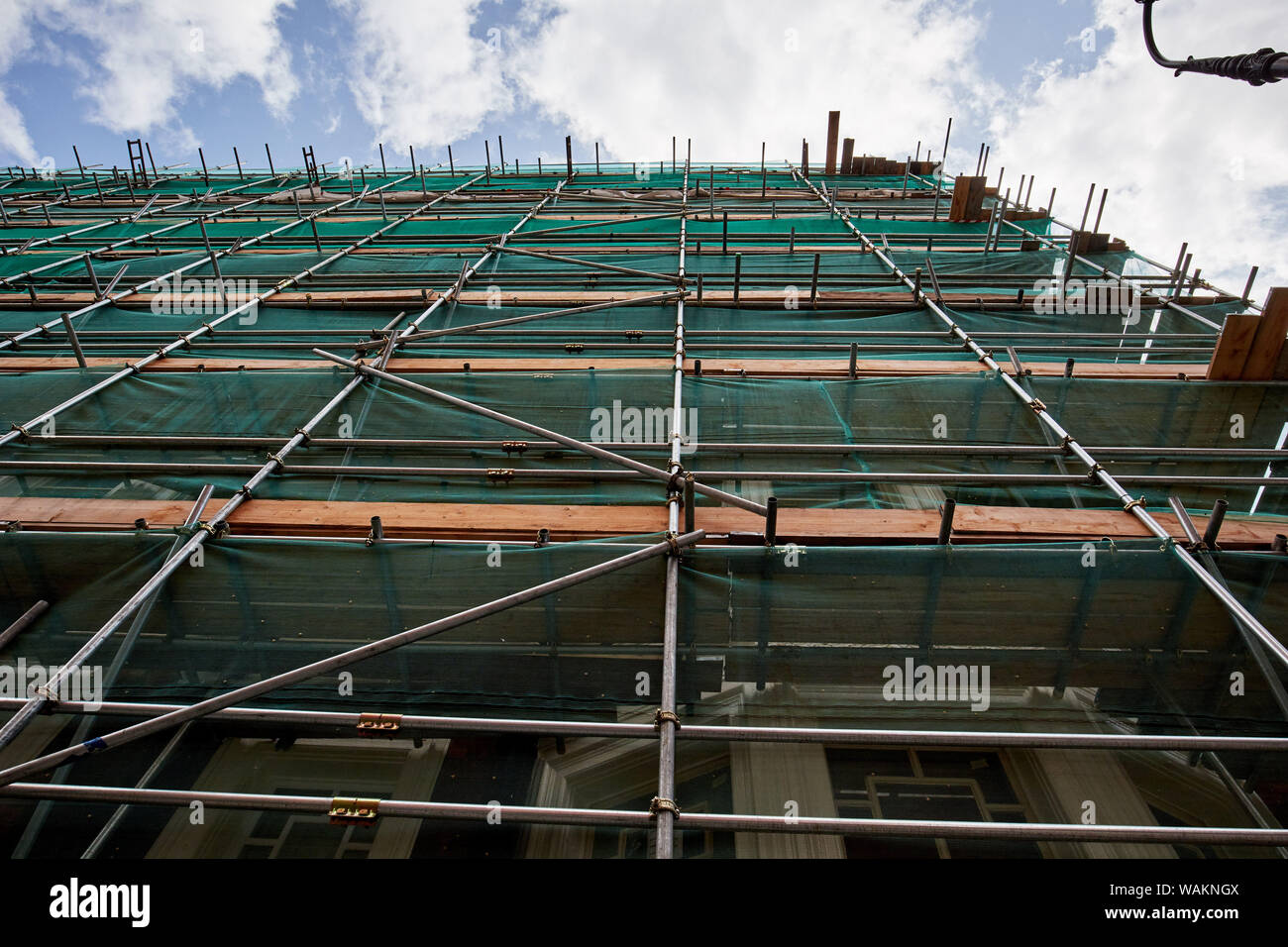 Professional scaffolding on the side of a building under renovation. Stock Photo
