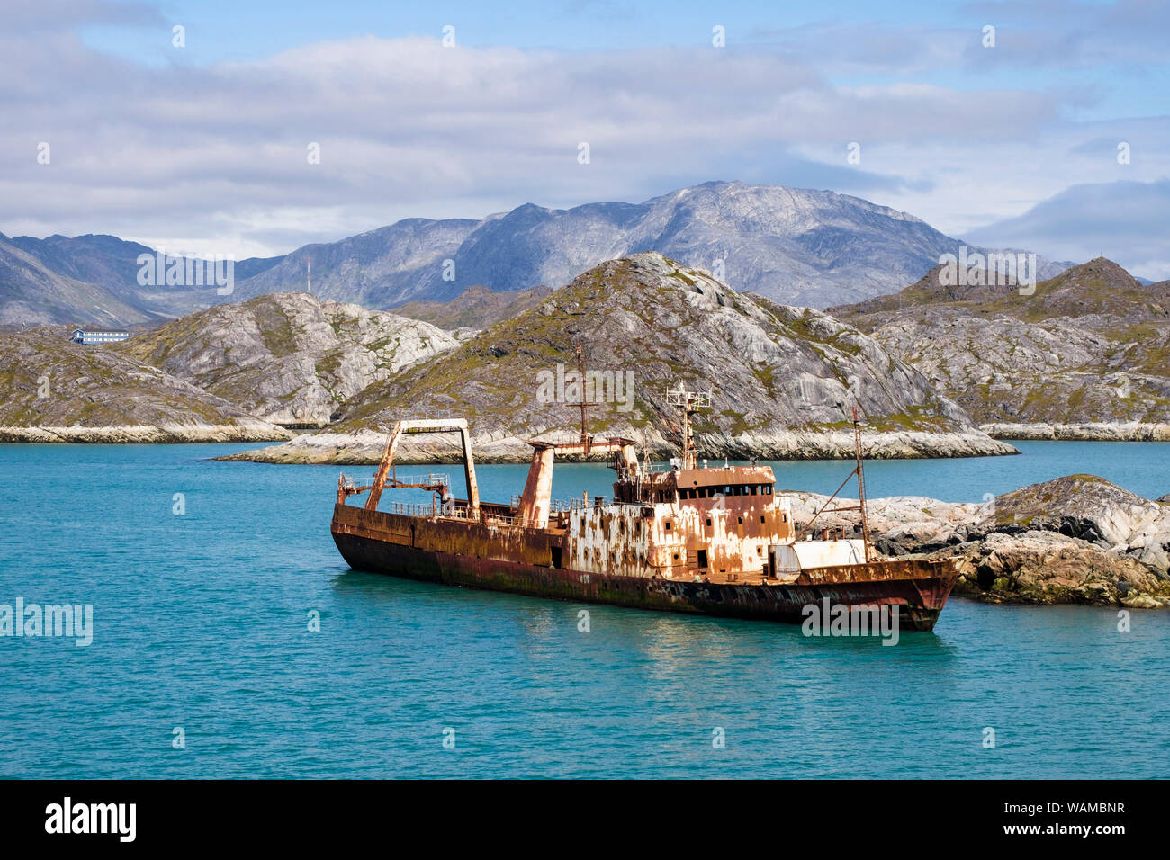Rusting abandoned old ship at sea in fjord near Paamiut (Frederikshåb), Sermersooq, Greenland Stock Photo