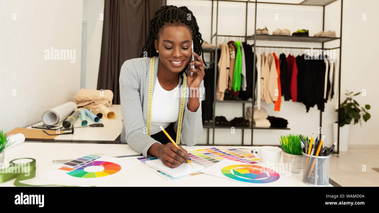 Young Black Fashion Designer Discussing Purchase With Client By Phone Stock Photo Alamy