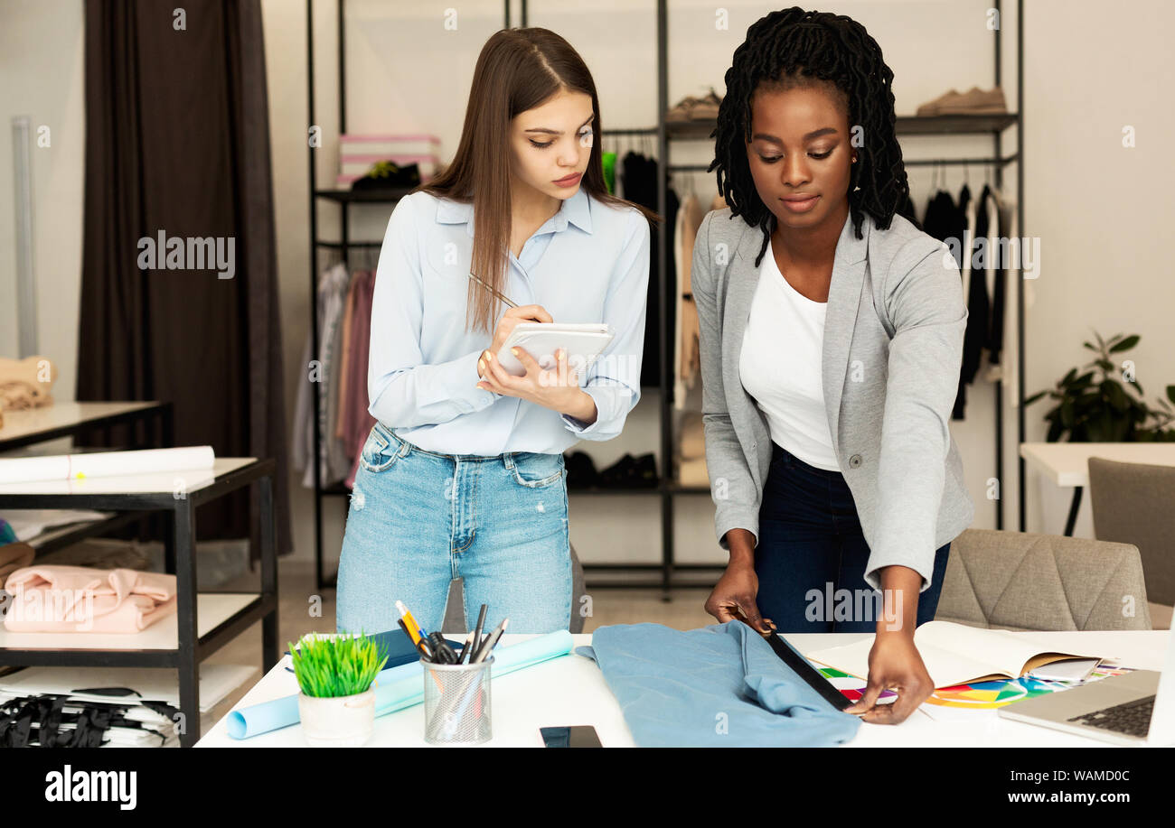 Young Fashion Designers Working On New Clothing Line In Atelier Stock Photo Alamy