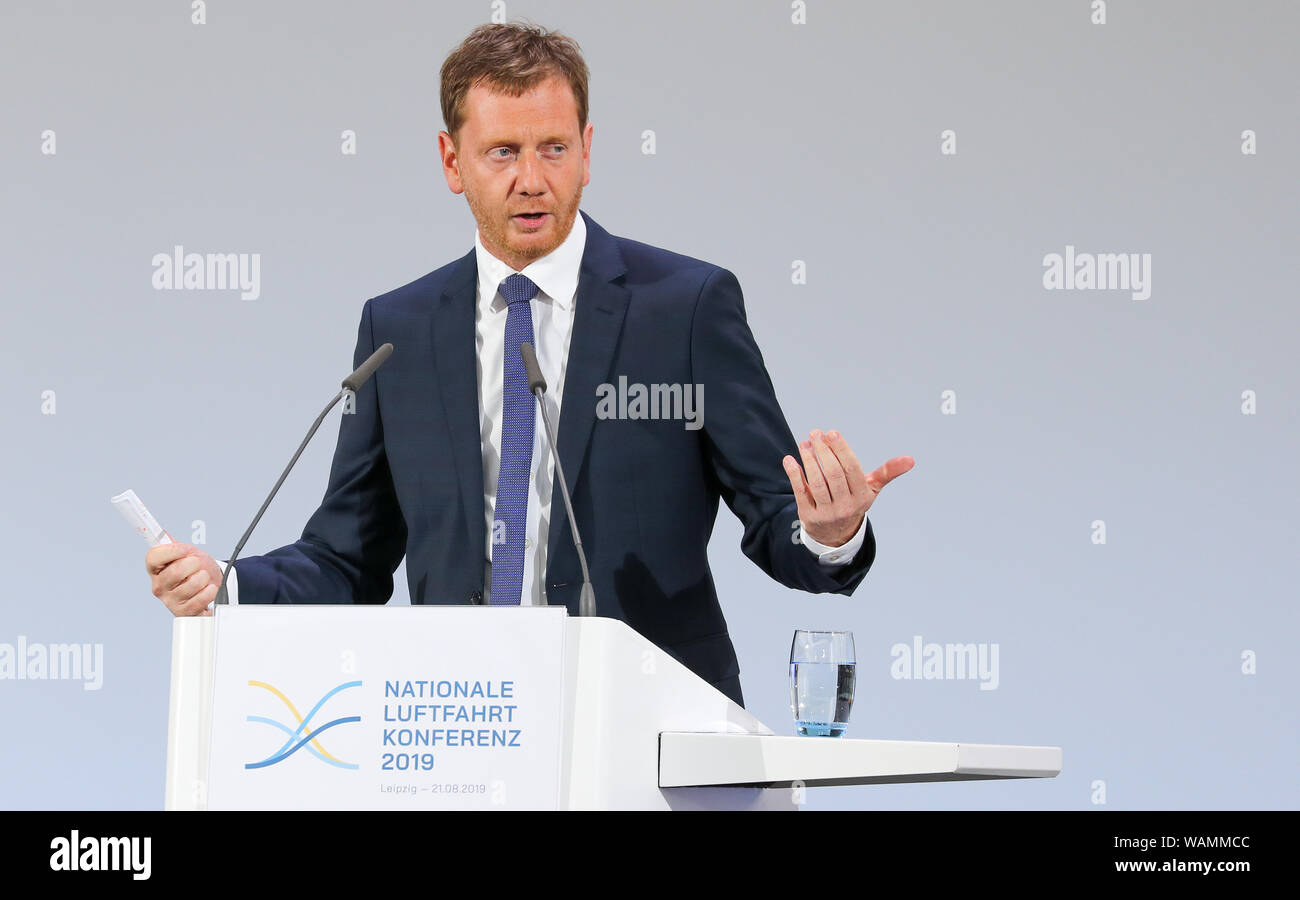 Schkeuditz, Germany. 21st Aug, 2019. Michael Kretschmer, Prime Minister of Saxony (CDU), speaks at the first National Aviation Conference at Leipzig-Halle Airport. Guiding principle of the conference: The German aviation industry should become more competitive and at the same time more environmentally friendly. Among those expected are the Federal Chancellor, the Minister of Transport, the Minister of Economics and the CEO of Lufthansa. Discussions are also likely to take place about the air traffic tax. Credit: Jan Woitas/dpa-Zentralbild/dpa/Alamy Live News Stock Photo