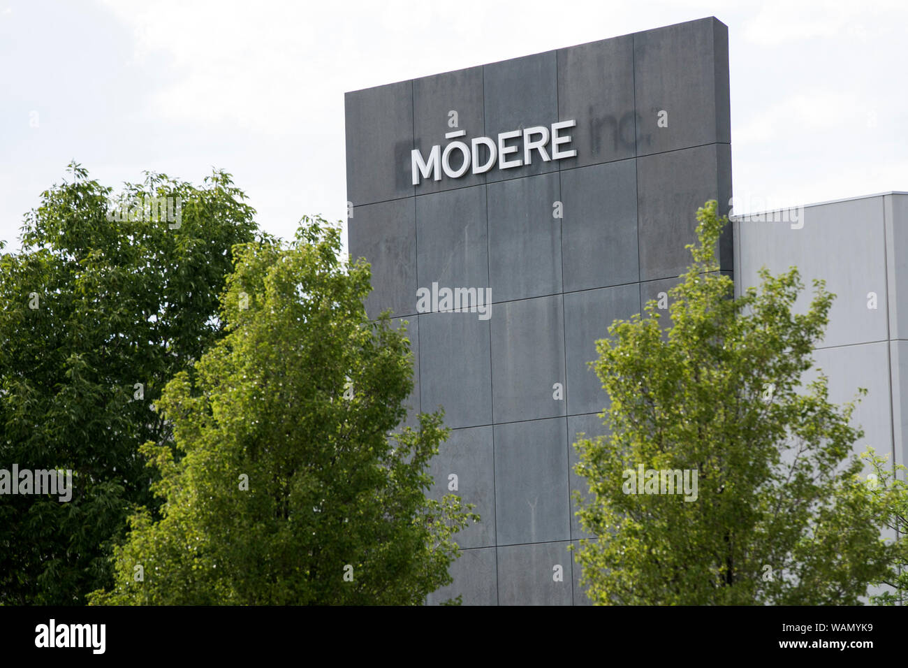A logo sign outside of the headquarters of Modere in Springville, Utah on July 29, 2019. Stock Photo