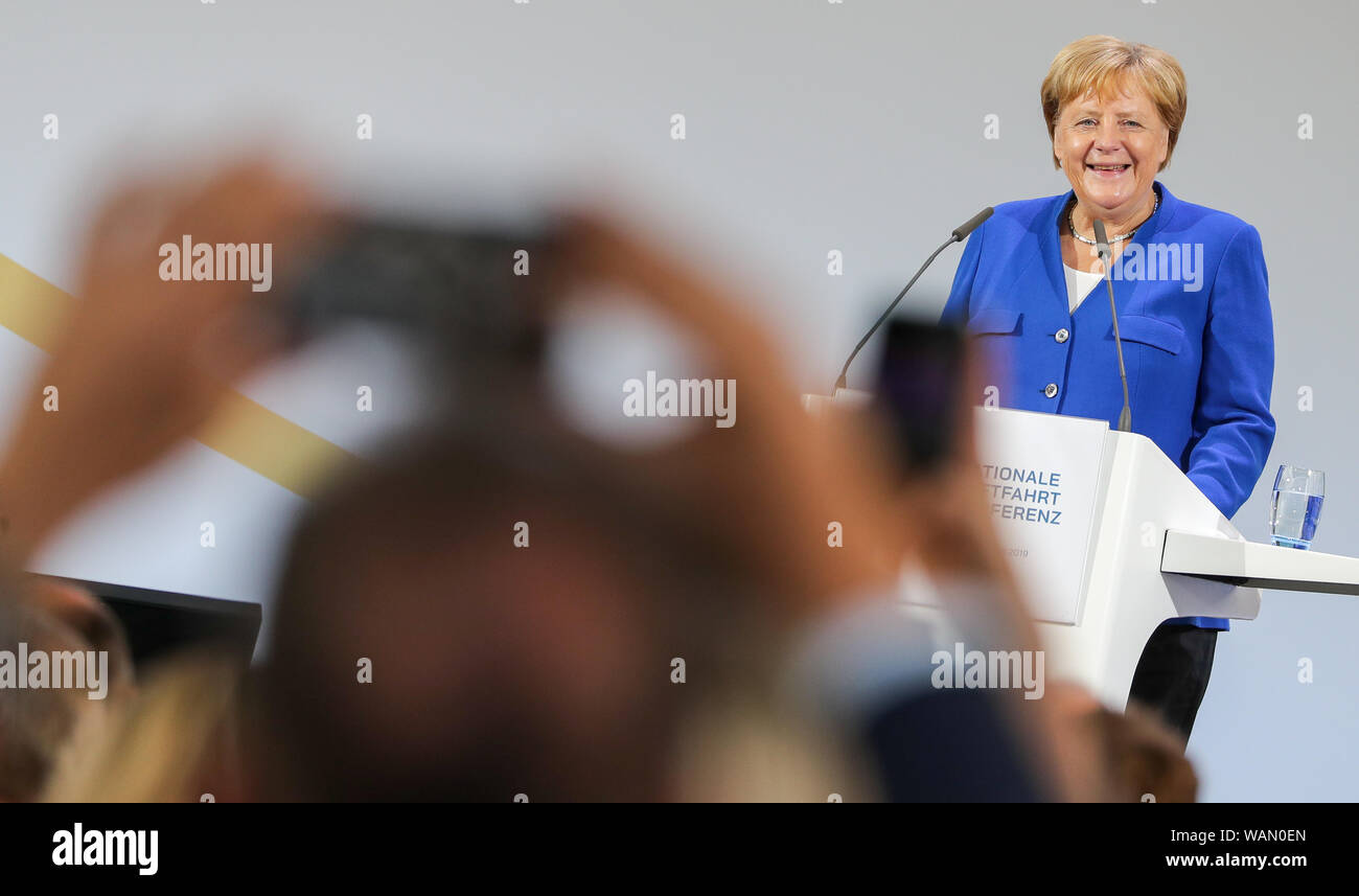 Schkeuditz, Germany. 21st Aug, 2019. Angela Merkel, Federal Chancellor (CDU), speaks at the first National Aviation Conference at Leipzig-Halle Airport. Guiding principle of the conference: The German aviation industry should become more competitive and at the same time more environmentally friendly. Among those expected are the Federal Chancellor, the Minister of Transport, the Minister of Economics and the CEO of Lufthansa. Discussions are also likely to take place about the air traffic tax. Credit: Jan Woitas/dpa-Zentralbild/dpa/Alamy Live News Stock Photo