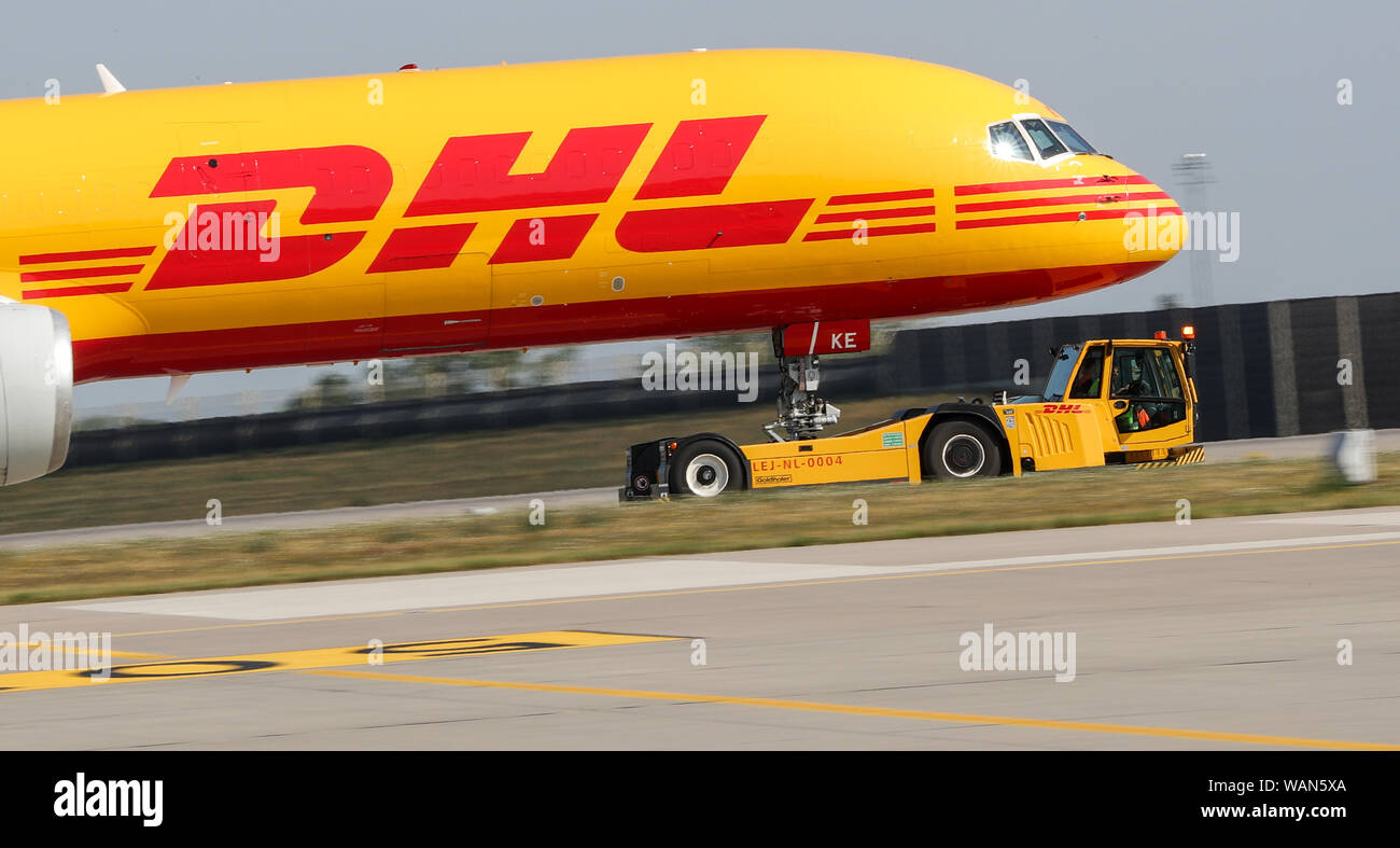 Schkeuditz, Germany. 21st Aug, 2019. A DHL cargo aircraft is towed to an apron position at Leipzig-Halle Airport. Credit: Jan Woitas/dpa-Zentralbild/dpa/Alamy Live News Stock Photo