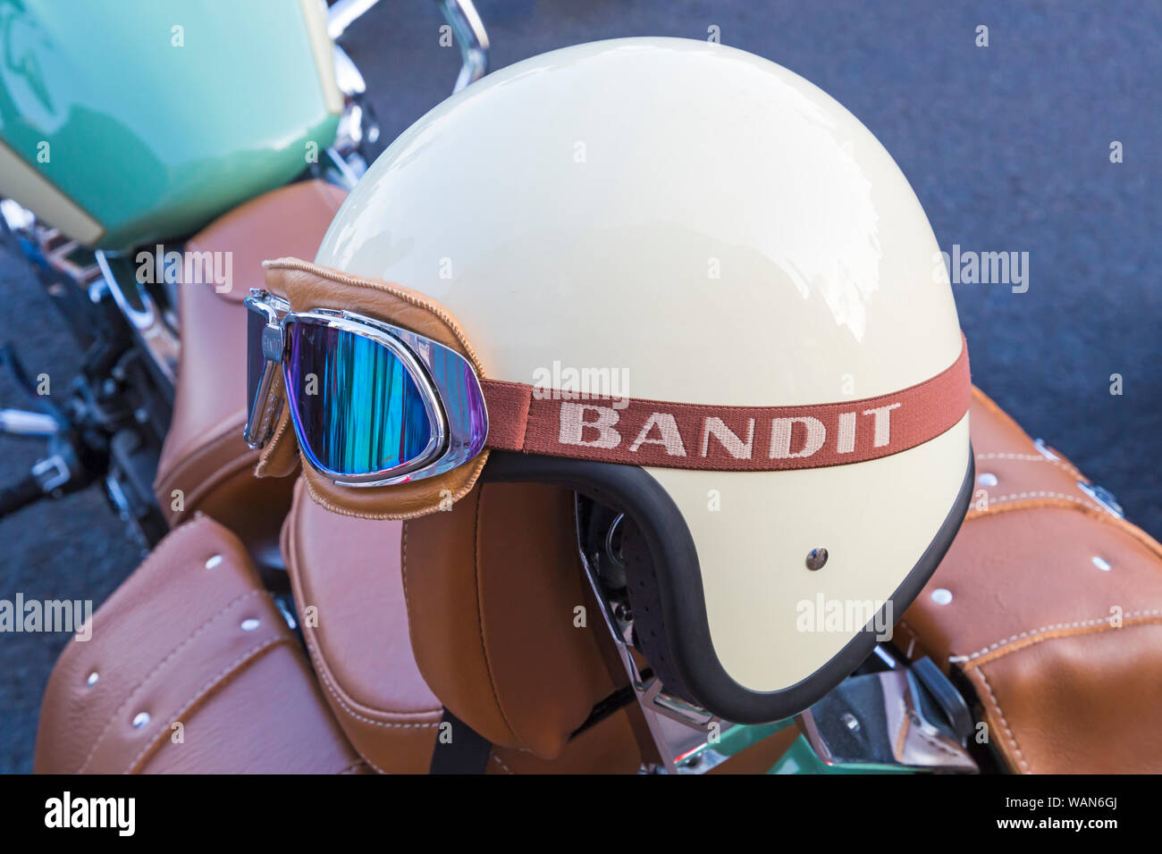 Bandit crash helmet with goggles on bike at bike night on Poole Quay, Poole, Dorset UK in August Stock Photo