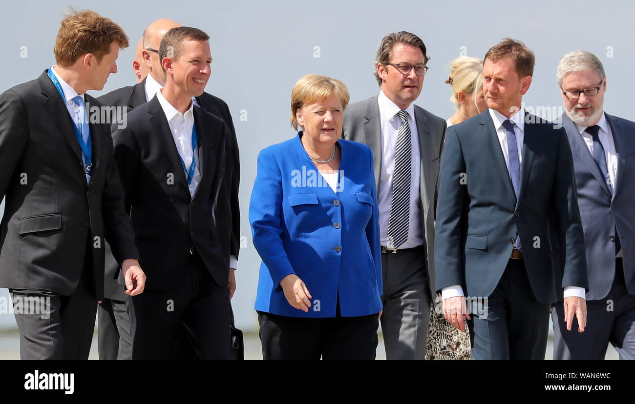 Schkeuditz, Germany. 21st Aug, 2019. Peter Altmaier (CDU 2nd from left), Federal Minister of Economics, Thomas Ogilvie (3rd from left), DHL Human Resources Director, Angela Merkel, Federal Chancellor (CDU, M), Andreas Scheuer (CSU, 4th from right), Federal Minister of Transport, Michael Kretschmer, Minister President of Saxony (CDU, 2nd from right), attend the first National Aviation Conference at Leipzig-Halle Airport. Credit: Jan Woitas/dpa-Zentralbild/dpa/Alamy Live News Stock Photo