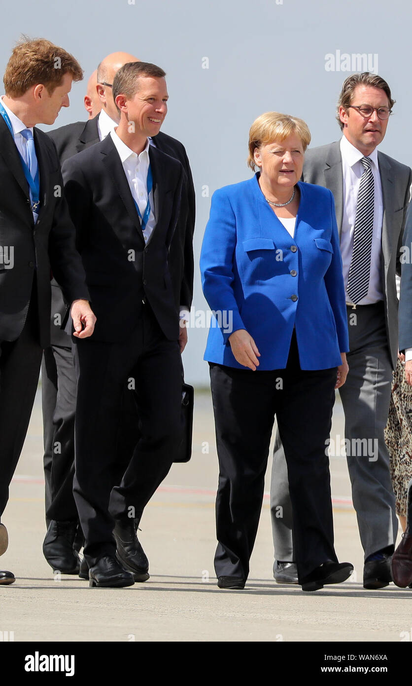 Schkeuditz, Germany. 21st Aug, 2019. Thomas Ogilvie (l) DHL's Chief Human Resources Officer, Angela Merkel, Federal Chancellor (CDU, M), and Andreas Scheuer (CSU), Federal Minister of Transport, attend the first National Aviation Conference at Leipzig-Halle Airport. Credit: Jan Woitas/dpa-Zentralbild/dpa/Alamy Live News Stock Photo