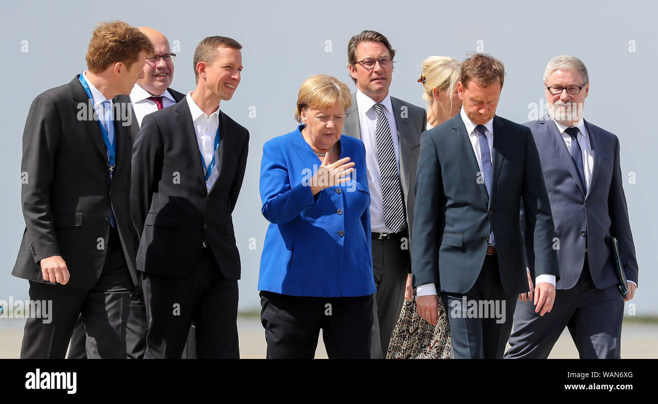 Schkeuditz, Germany. 21st Aug, 2019. Peter Altmaier (CDU 2nd from left), Thomas Ogilvie (3rd from left), DHL Human Resources Director, Federal Minister of Economics, Angela Merkel, Federal Chancellor (CDU, M), Andreas Scheuer (CSU, 4th from right), Federal Minister of Transport, Michael Kretschmer, Minister President of Saxony (CDU, 2nd from right), attend the first National Aviation Conference at Leipzig-Halle Airport. Credit: Jan Woitas/dpa-Zentralbild/dpa/Alamy Live News Stock Photo