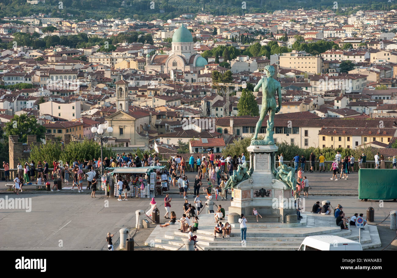 Florence, Italy - 2019, August 16: David statue at Piazzale Michelangelo.Tourists and visitors crowd the square in a summer day. Stock Photo