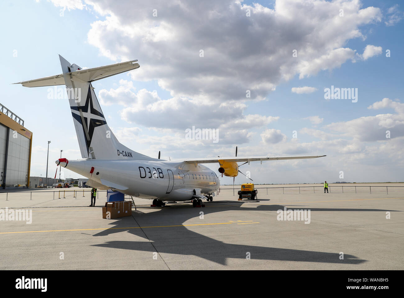 Schkeuditz, Germany. 21st Aug, 2019. A Dornier 328 is standing on the sidelines of the National Aviation Conference at Leipzig-Halle Airport. Credit: Jan Woitas/dpa-Zentralbild/dpa/Alamy Live News Stock Photo