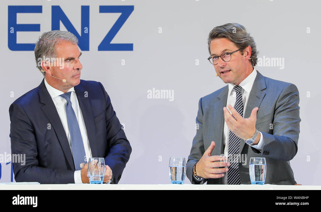 Schkeuditz, Germany. 21st Aug, 2019. Andreas Scheuer (CSU, r), Federal Minister of Transport, and Carsten Spohr, Chairman of the Executive Board of Deutsche Lufthansa AG, are on the podium at the first National Aviation Conference at Leipzig-Halle Airport. Credit: Jan Woitas/dpa-Zentralbild/dpa/Alamy Live News Stock Photo