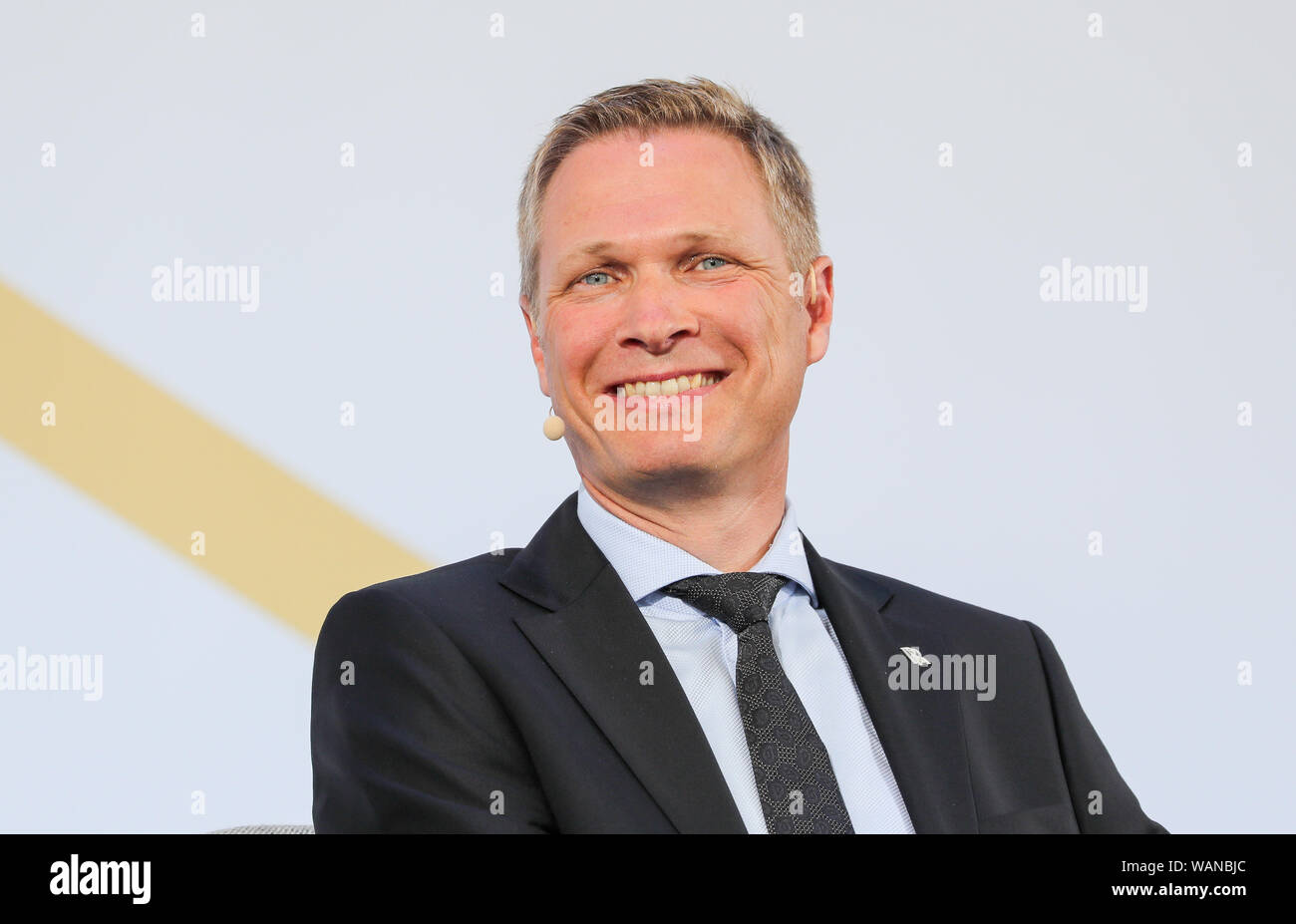 Schkeuditz, Germany. 21st Aug, 2019. Dirk Geisinger, CEO of the engine manufacturer Rolls-Royce, sits on the podium of the first National Aviation Conference at Leipzig-Halle Airport. Credit: Jan Woitas/dpa-Zentralbild/dpa/Alamy Live News Stock Photo