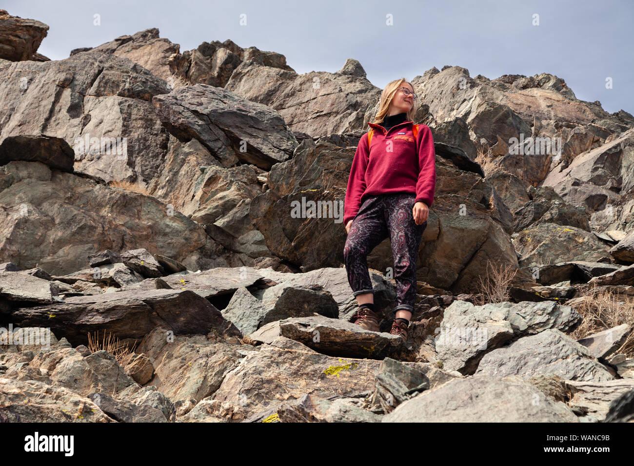 Mongolia Ulgii 2019-05-04 European scandinavian blonde girl in glasses with backpack do hiking, mountain climbing, walking, hiking. Freedom concept, t Stock Photo