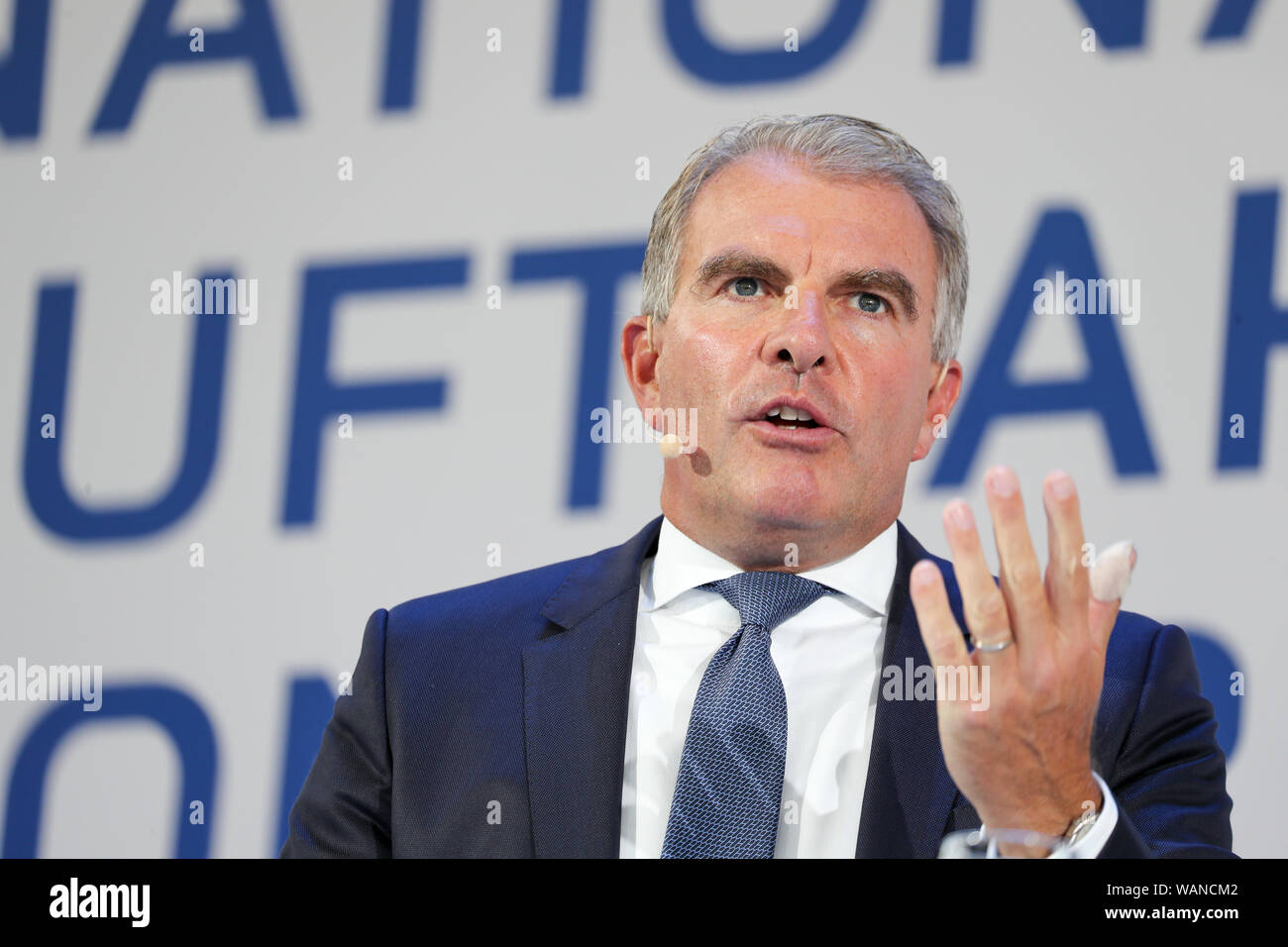 Schkeuditz, Germany. 21st Aug, 2019. Carsten Spohr, Chairman of the Executive Board of Deutsche Lufthansa AG, is on the podium at the first National Aviation Conference at Leipzig-Halle Airport. Credit: Jan Woitas/dpa-Zentralbild/dpa/Alamy Live News Stock Photo