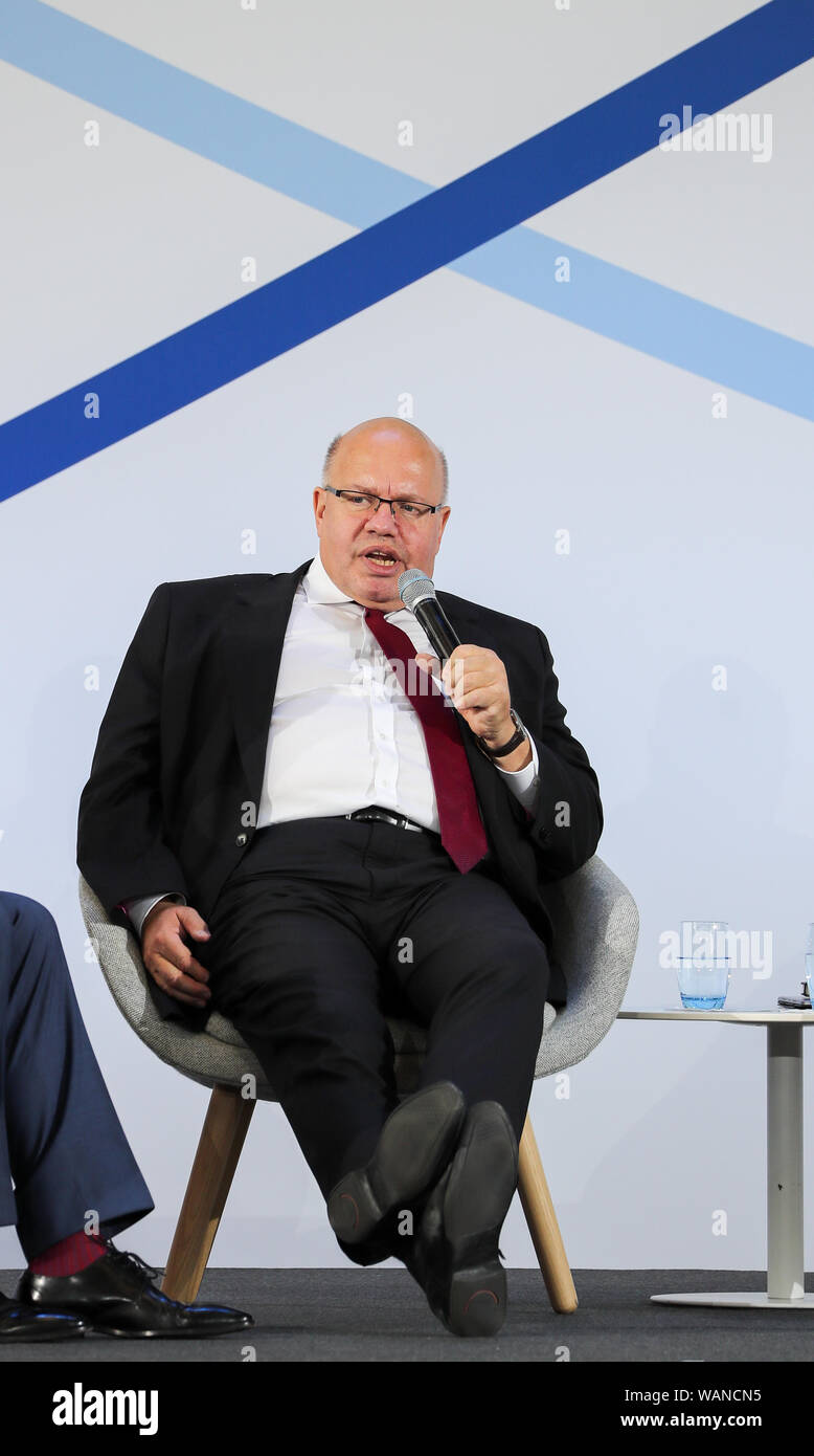 Schkeuditz, Germany. 21st Aug, 2019. Peter Altmaier (CDU, l), Federal Minister of Economics, speaks at the first National Aviation Conference at Leipzig-Halle Airport. Credit: Jan Woitas/dpa-Zentralbild/dpa/Alamy Live News Stock Photo