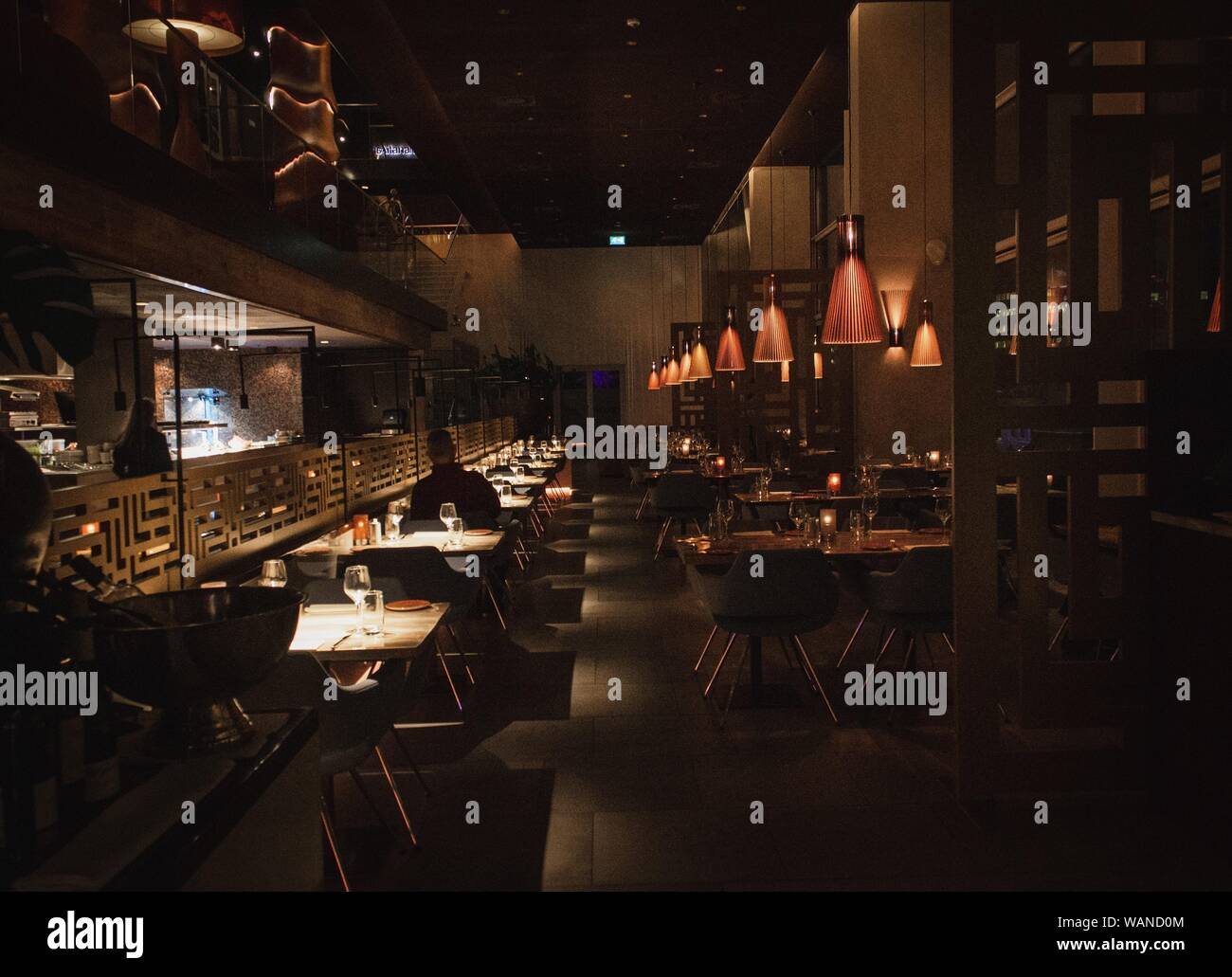 An Interior Shot Of A Dark Cafe With Light Brown Walls And Lights Hanging Off The Ceiling Stock Photo Alamy