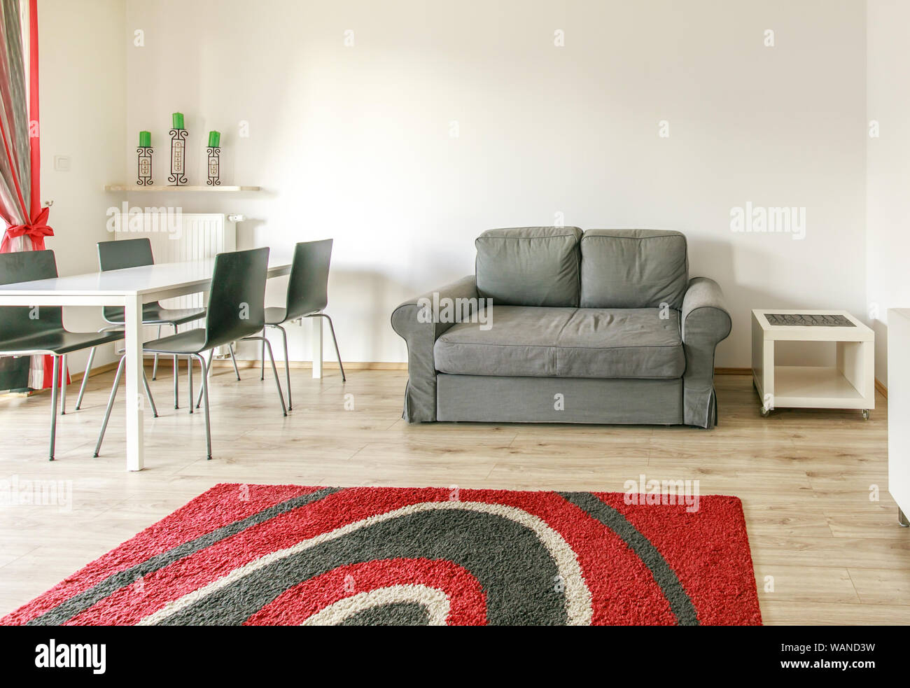 New Furnished Apartment White Living Room With Black And Red Carpet Grey Sofa And A Nice View Stock Photo Alamy