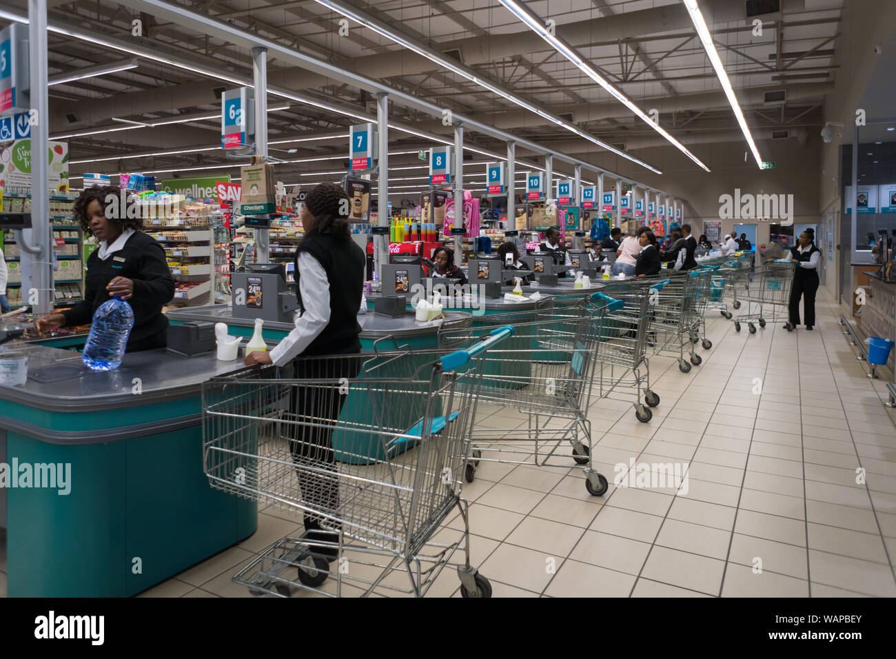 Interior of an African supermarket with many cash pay points or till points and people in Hazyview, Mpumalanga, South Africa Stock Photo